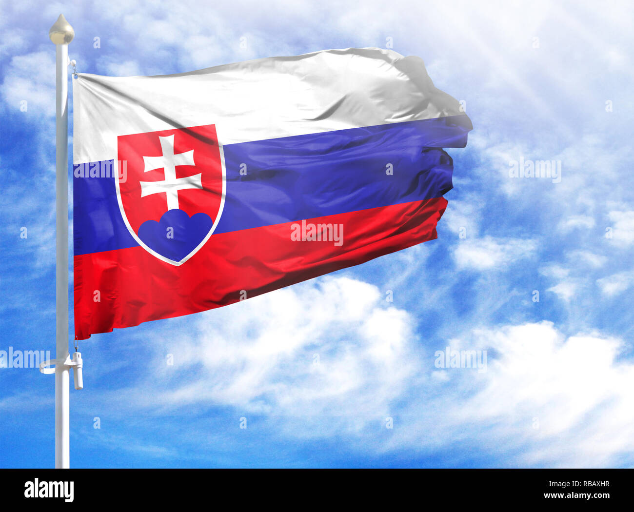 National flag of Slovakia on a flagpole in front of blue sky. - Stock Image