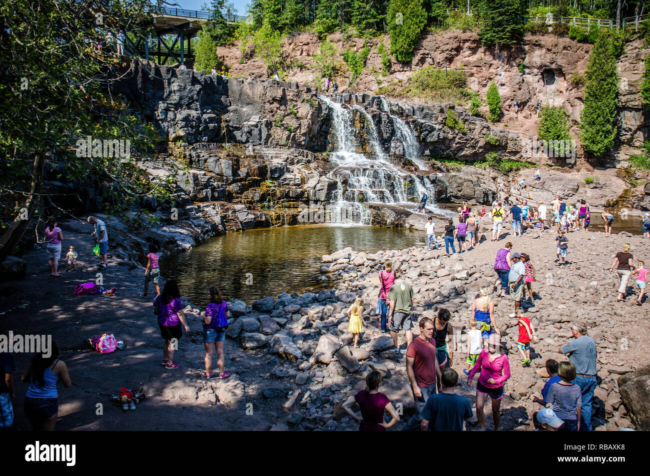 Duluth, Minnesota - August 21, 2018: Gooseberry Falls, a popular waterfall near Lake Superior, attracts a crowd of visitors on a summer day. - Stock Image