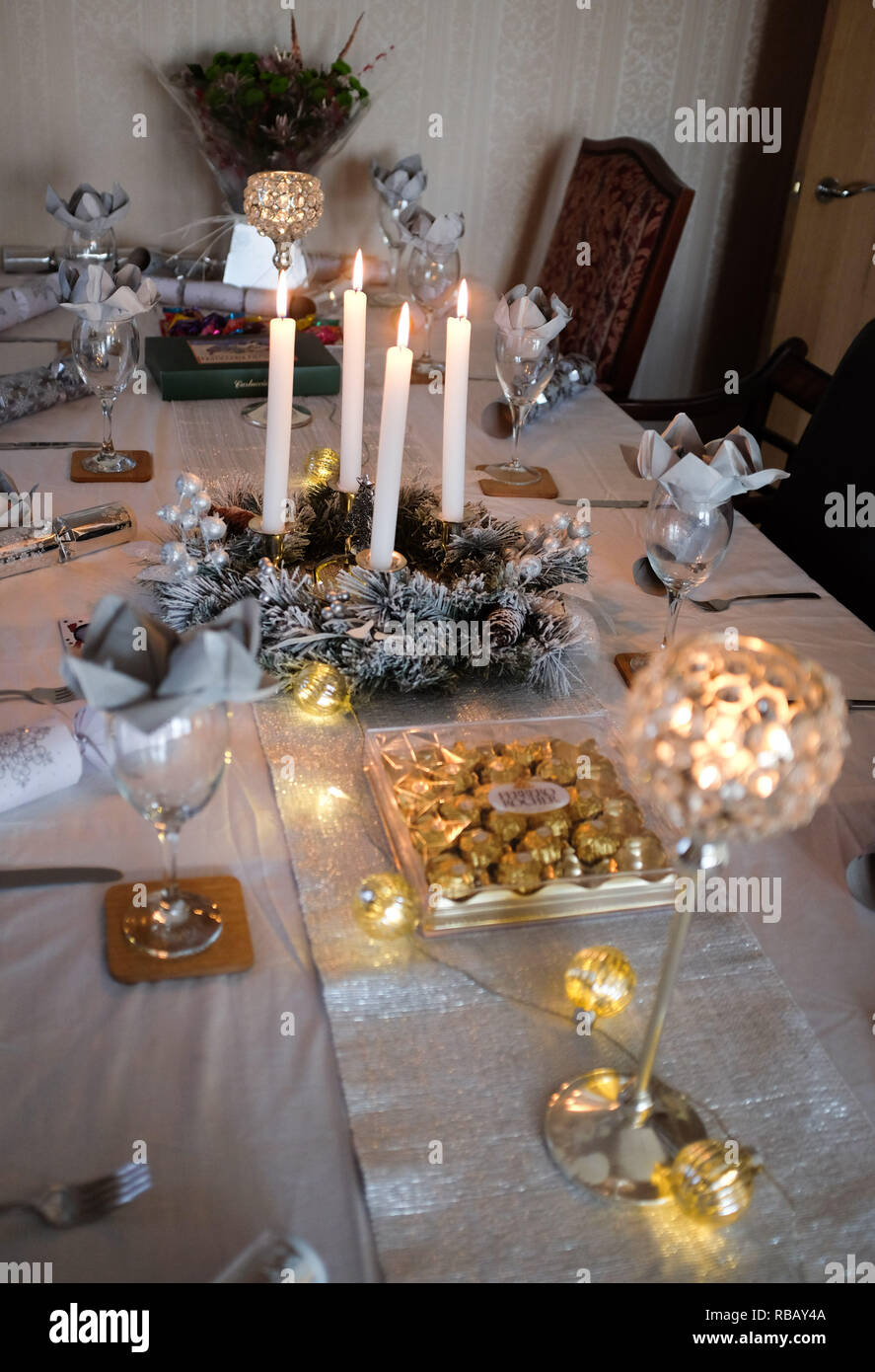 Table set for festive meal at Christmas - Stock Image
