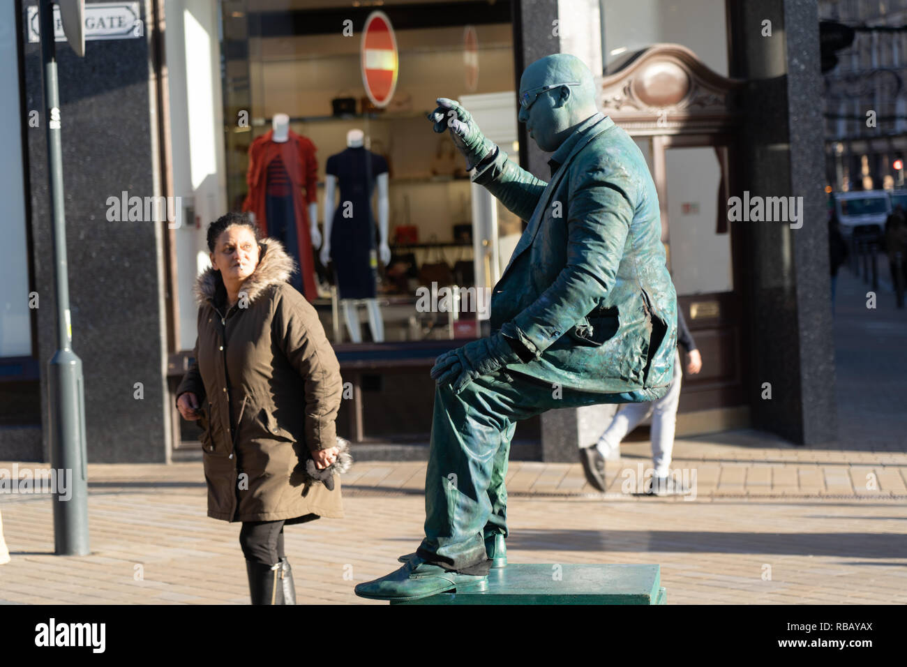Living levitating statue waving at a passer by in Briggate,Leeds,West Yorkshire,England,UK. - Stock Image