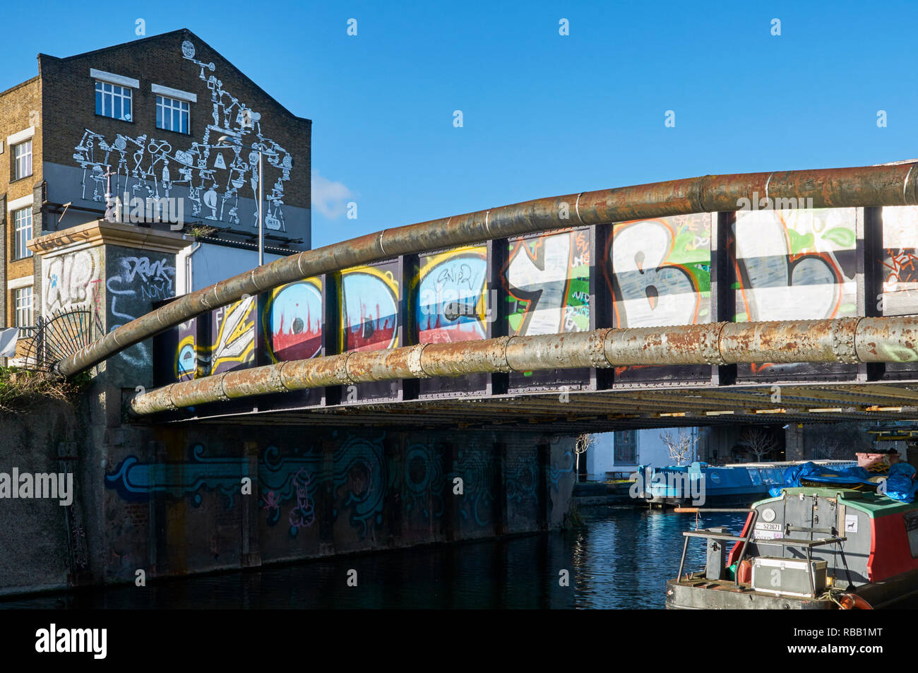 Bridge with graffiti over the River Lea Navigation at Hackney Wick, East London UK - Stock Image