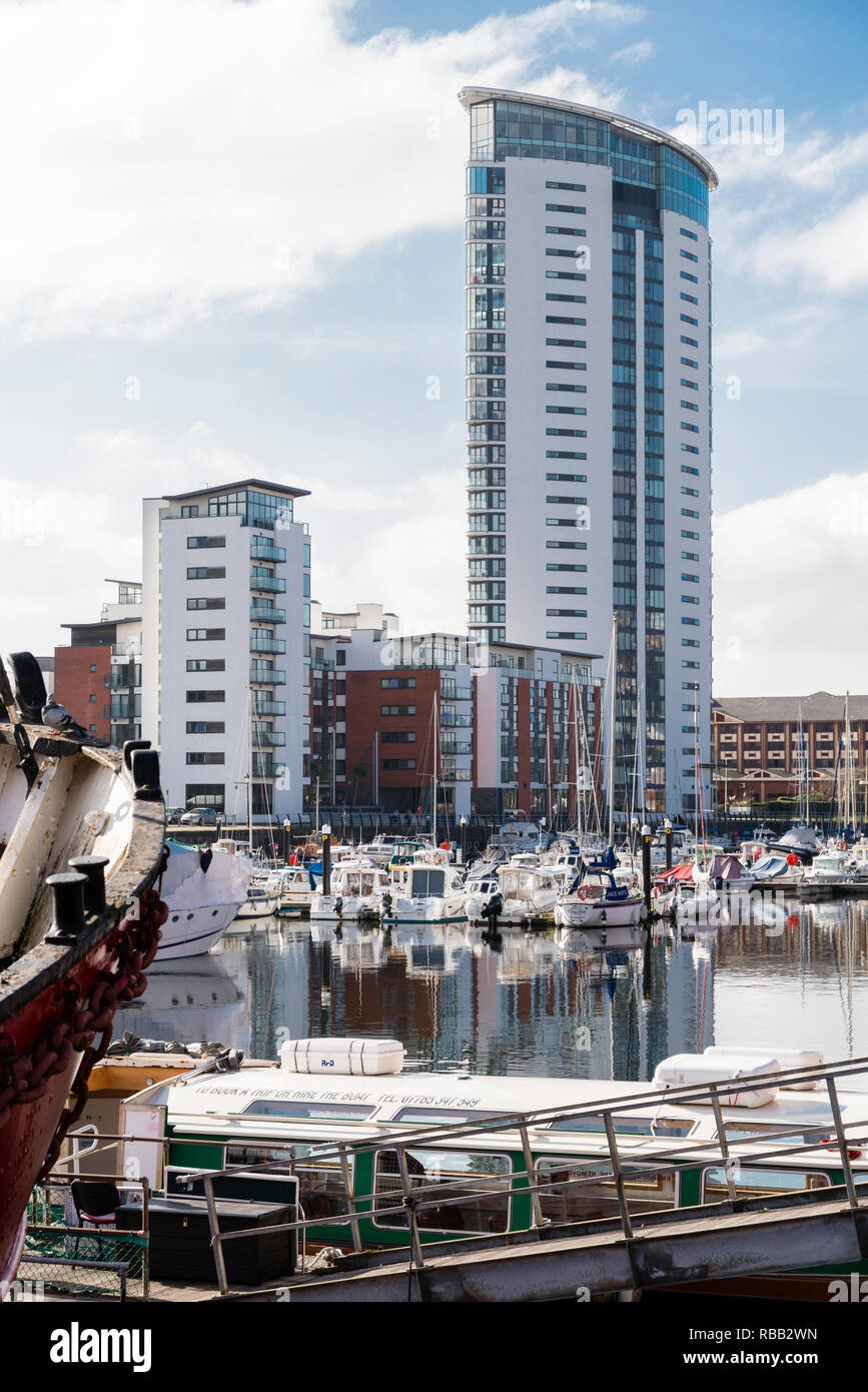 The newly renovated docks at Swansea in South Wales with leisure boats and multistorey flats. - Stock Image