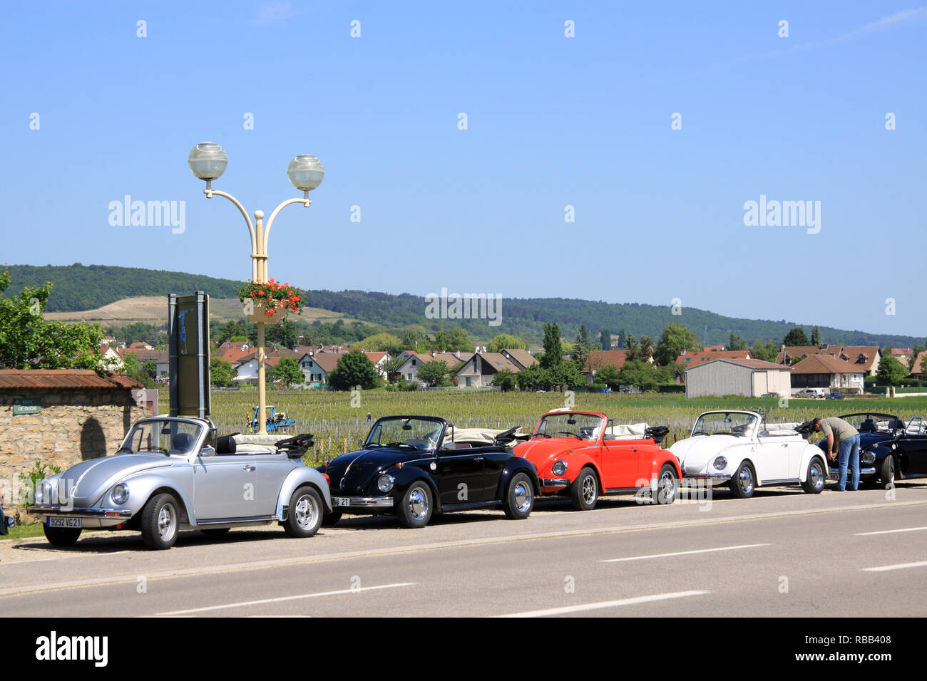 Volkswagen beetle cabriolet convertible in the Burgundy town of Gevrey- Chambertin France on an owners club rally drive outing in French countryside - Stock Image