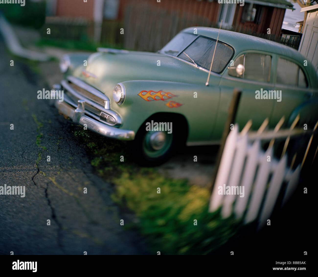 Vintage car parked in a driveway - Stock Image