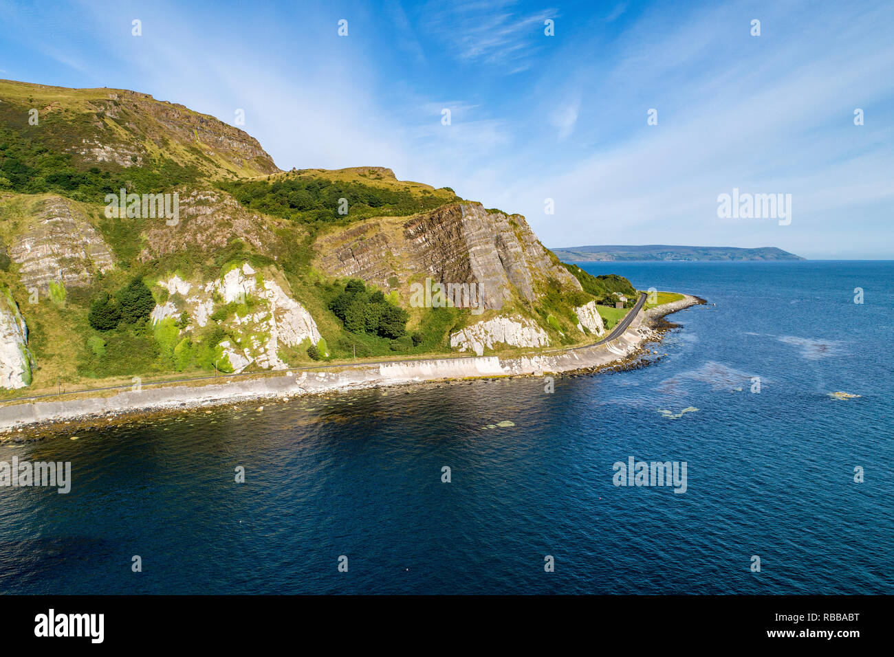 Northern Ireland, UK. Atlantic coast. Cliffs and A2 Antrim Coast Road, a.k.a. Giants Causeway Coastal Route. One of the most scenic coastal roads - Stock Image