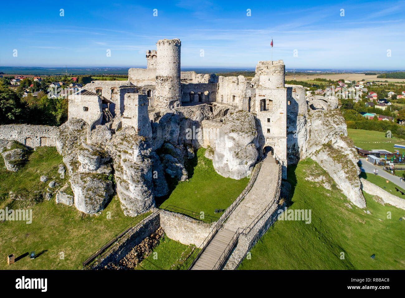 The ruins of medieval castle on the rock in Ogrodzieniec, Poland. One of strongholds  called Eagles Nests in Polish Jurassic Highland in Silesia. Stock Photo