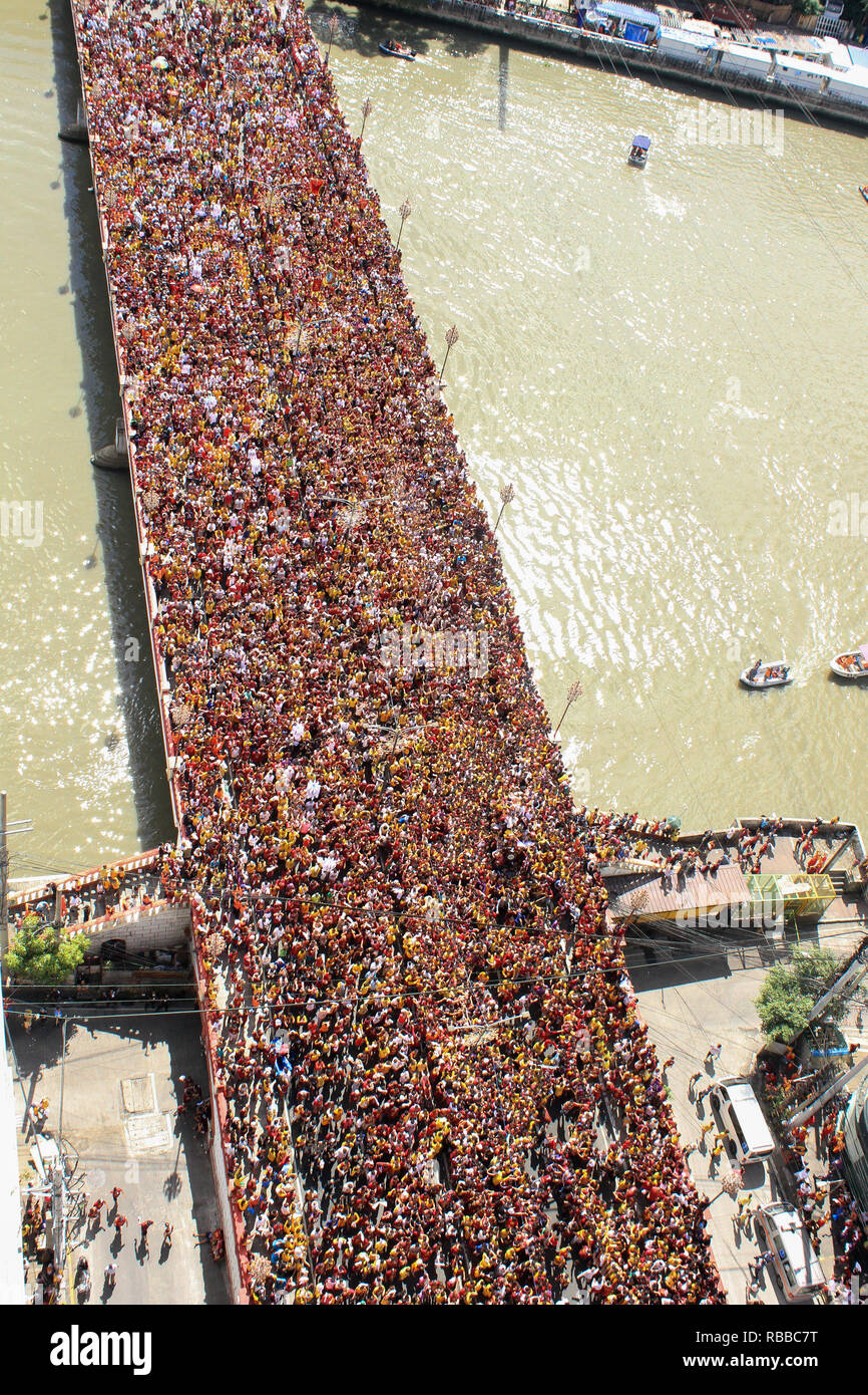Manila, Philippines. 09th Jan, 2019. An estimated 21 million have and are currently participating the 2019 feast of the Black Nazarene today, January 9. The feast commemorates the transfer or Traslacion of the miraculous image of the Black Nazarene from the San Nicolas de Tolentino at Intramuros to the Quiapo Church in the year 1787. Credit: Dennis Jerome Acosta/ Pacific Press/Alamy Live News - Stock Image