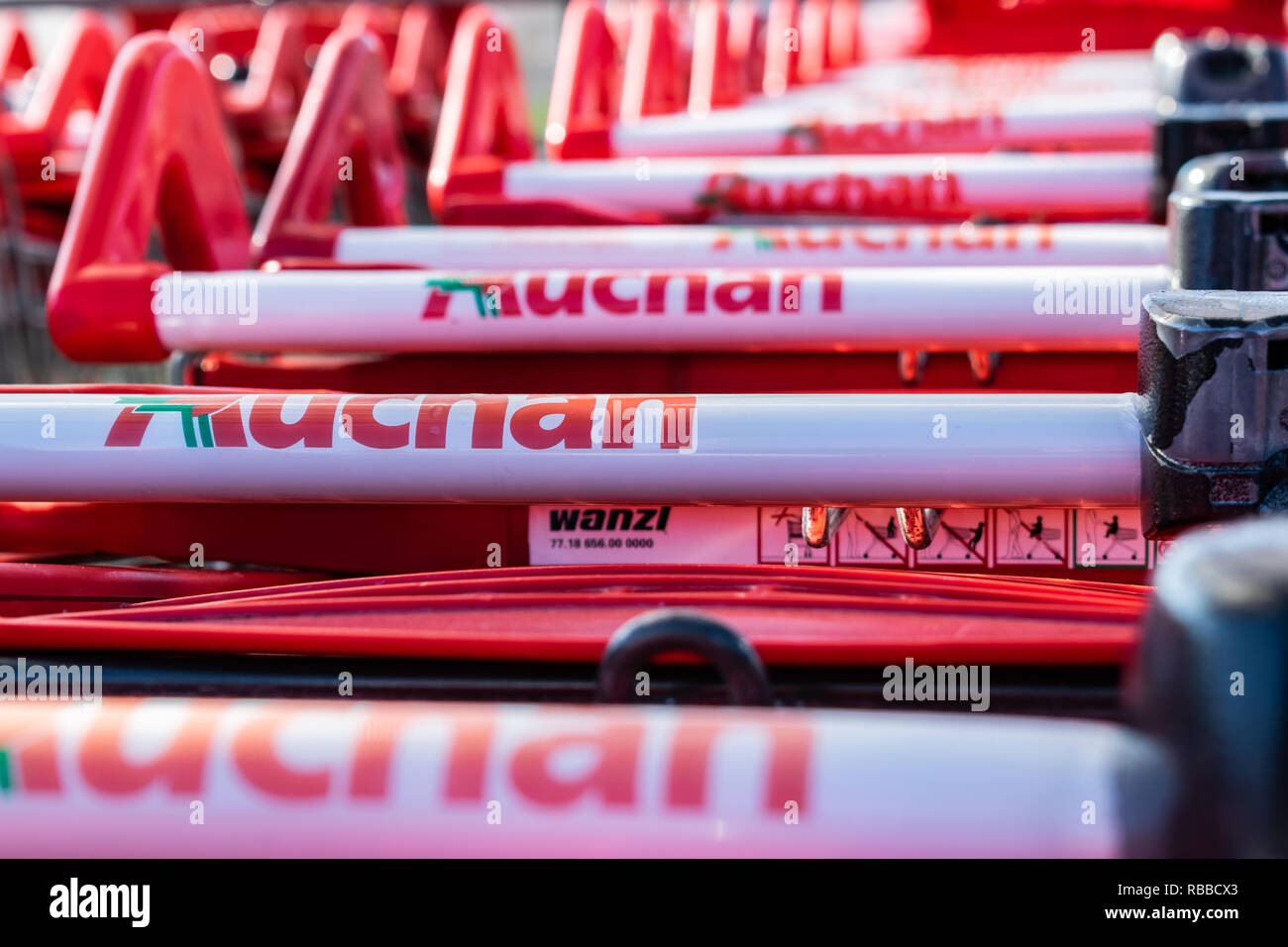 Roncq,FRANCE-February 25,2018  Close-up shopping trolleys Auchan  hypermarket.Auchan is a French international supermarket chain. 479d4d085d30