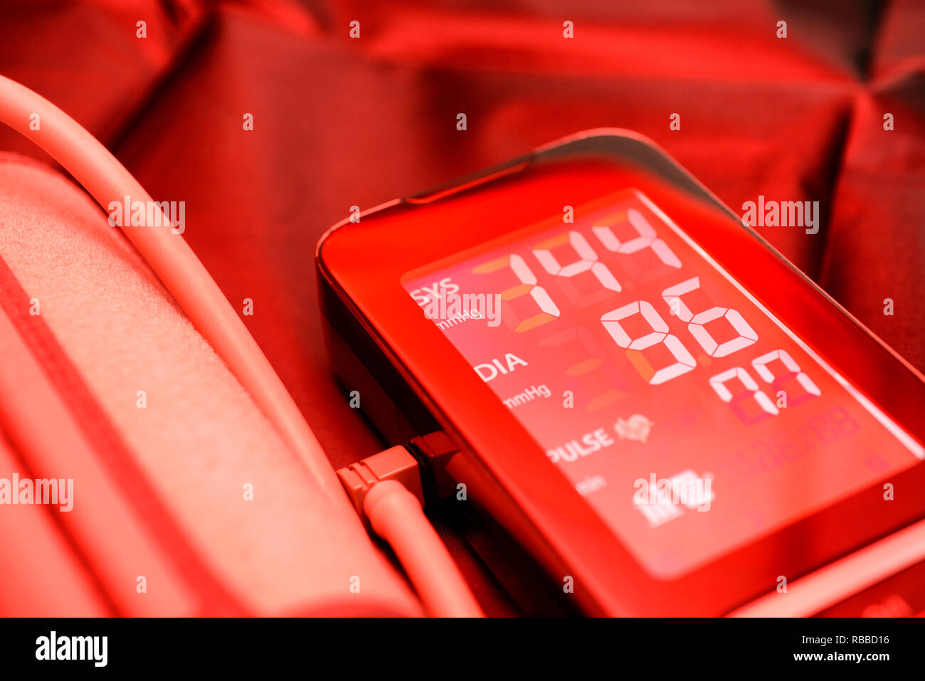 equipment for measuring blood pressure in red colors. - Stock Image