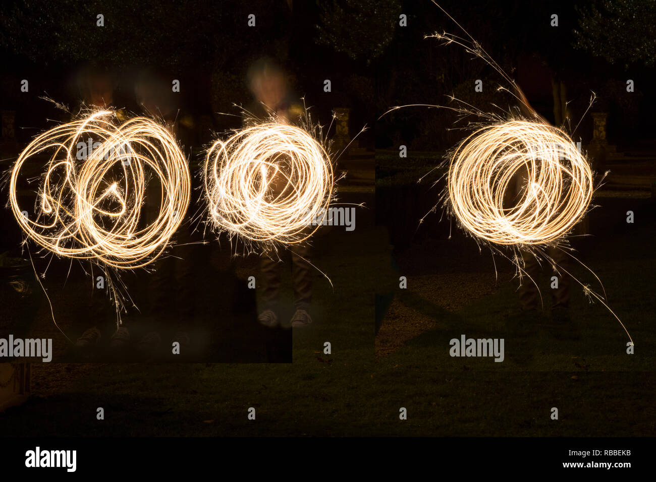 sparklers being whizzed around on a wedding day in the semi dark, by wedding guests, sparkler patterns in the dark, long exposure - Stock Image