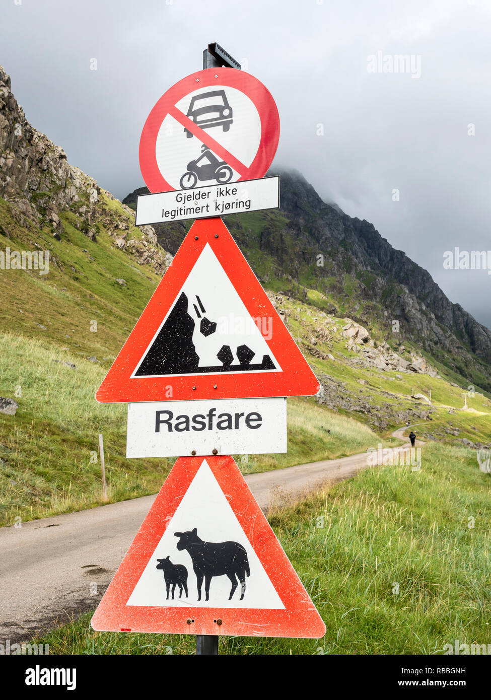 Old pass, mountain road from Haukland beach to Uttakleiv, warning signs, no public traffic, be aware of sheep and avalanches, Utakleiv, island Vestvag Stock Photo