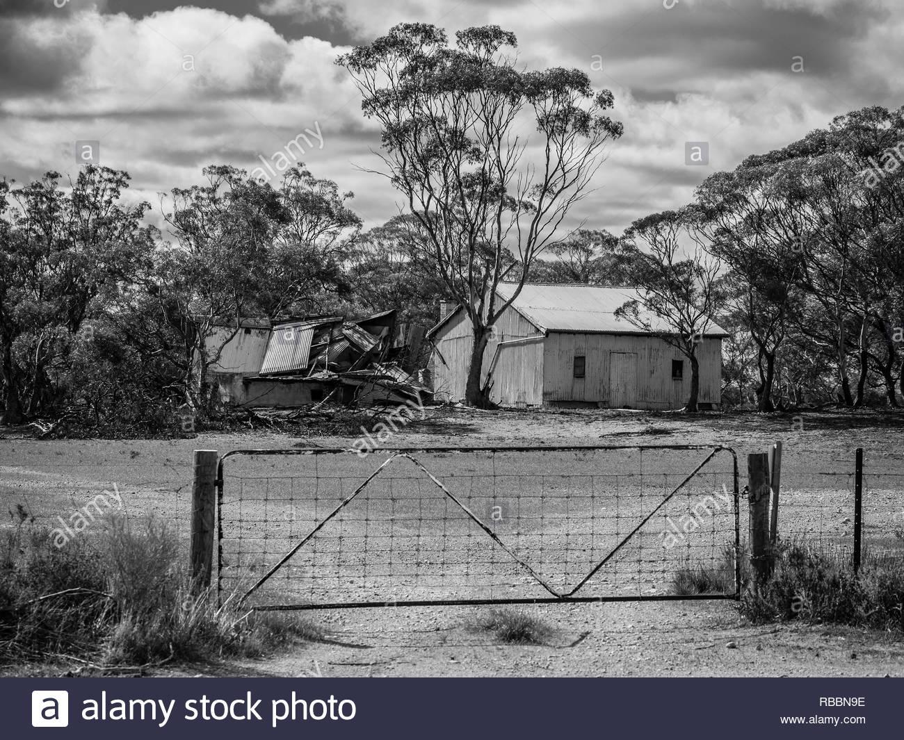 Burned Ruins and Tin Residence. Riverland, SA - Black and White - Stock Image