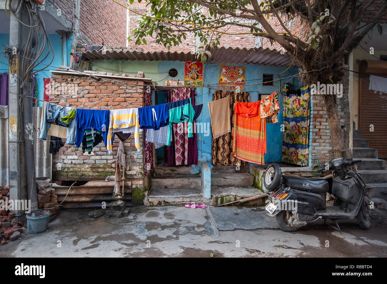 The Front Yard of a house in Madanpur Khadar, New Delhi. Through the front yard the street becomes part of the home. - Stock Image