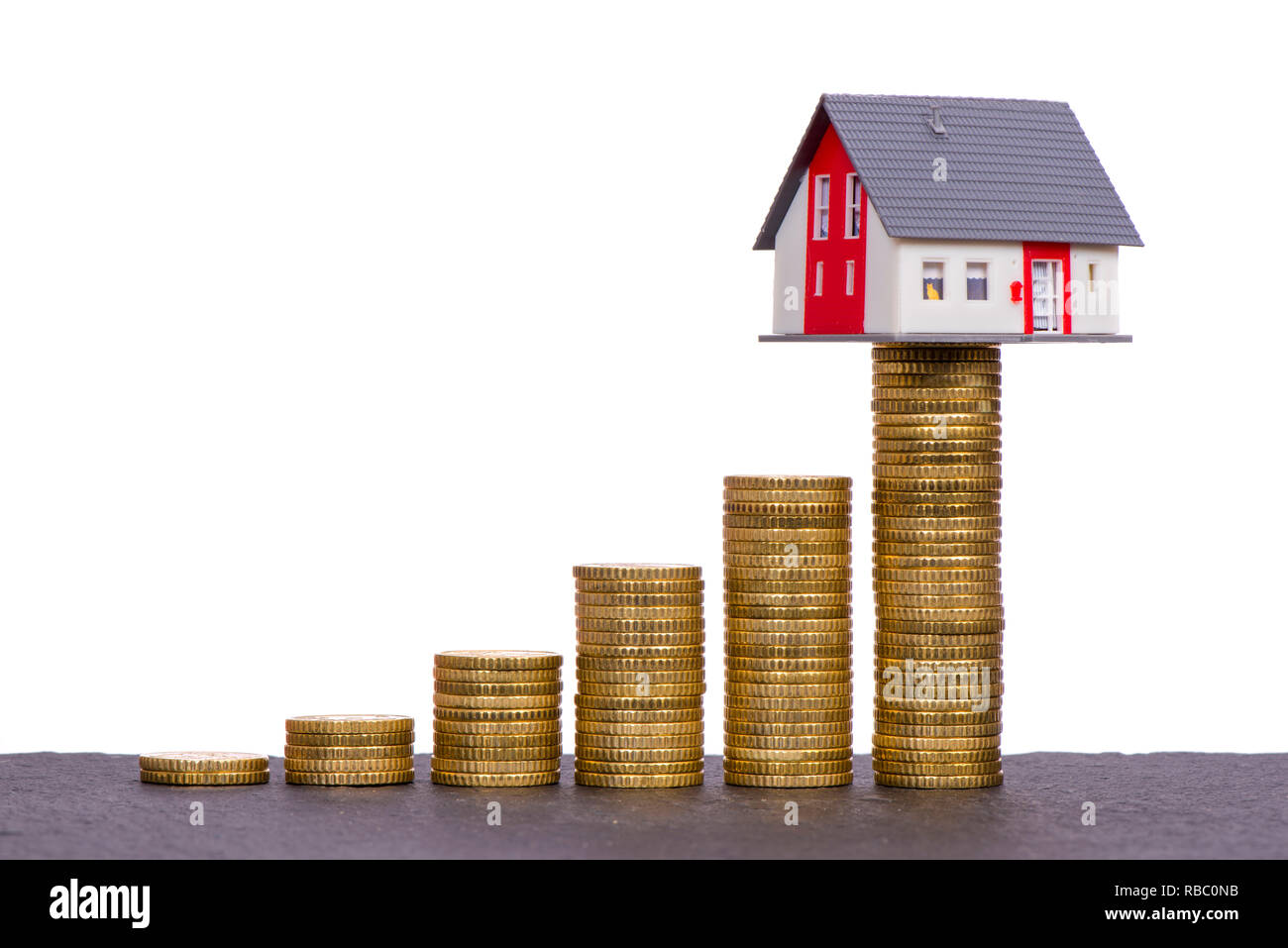chart of Euro coins with model home on top - Stock Image