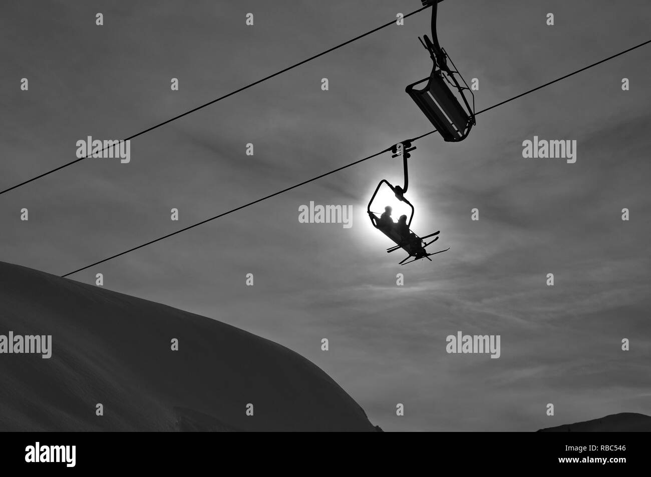 Ski lift silhouette in winter - Stock Image
