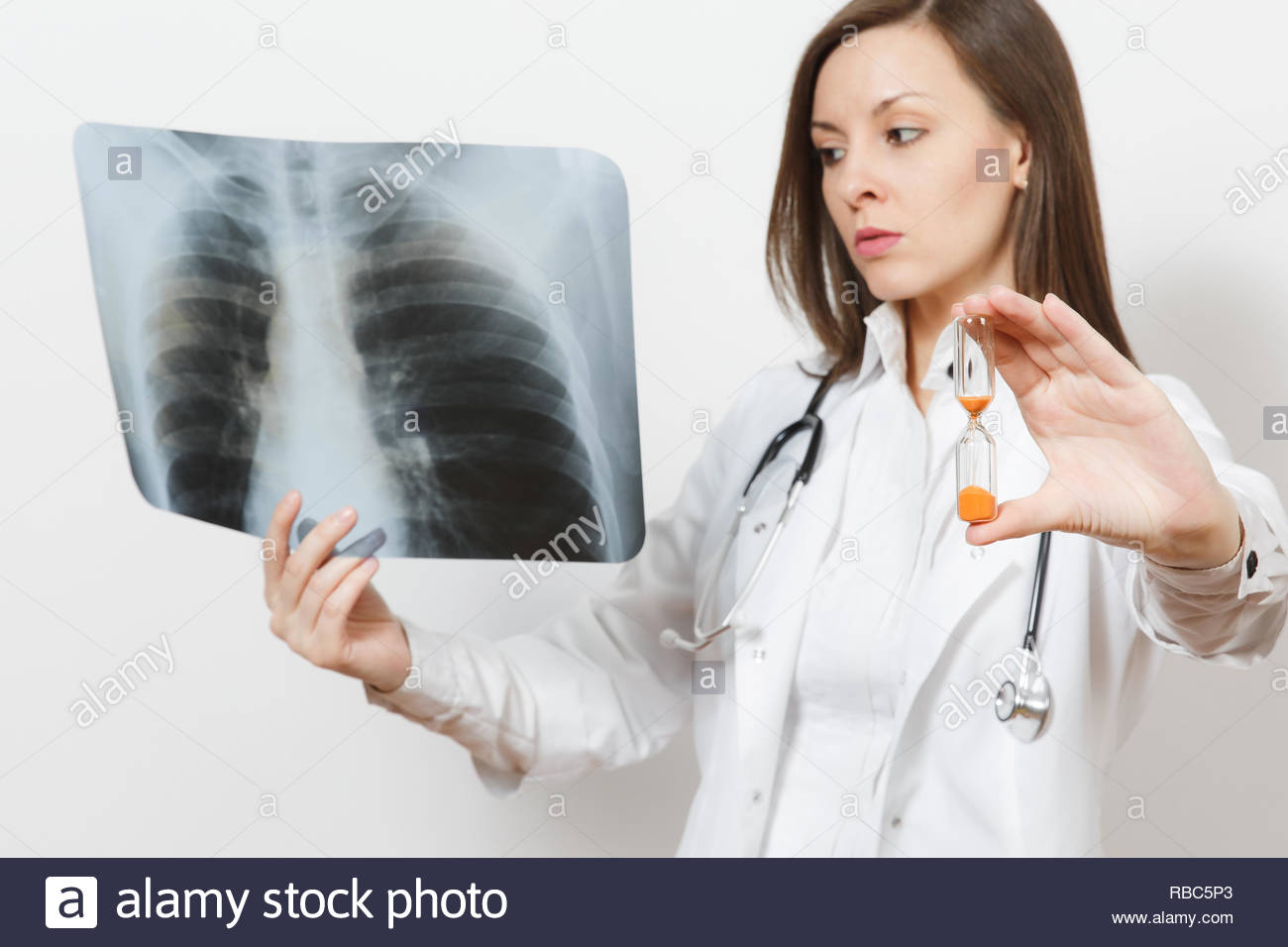 Doctor woman with hourglass, X-ray of lungs fluorography roentgen isolated on white background. Female doctor in medical gown stethoscope. Healthcare  - Stock Image