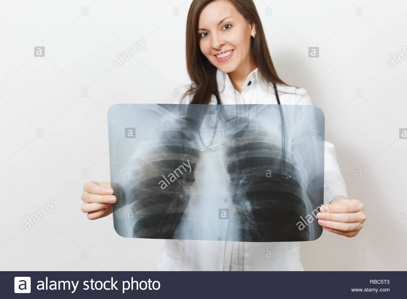 Close up cropped doctor woman with X-ray of lungs, fluorography, roentgen isolated on white background. Female doctor in medical gown stethoscope. Hea - Stock Image