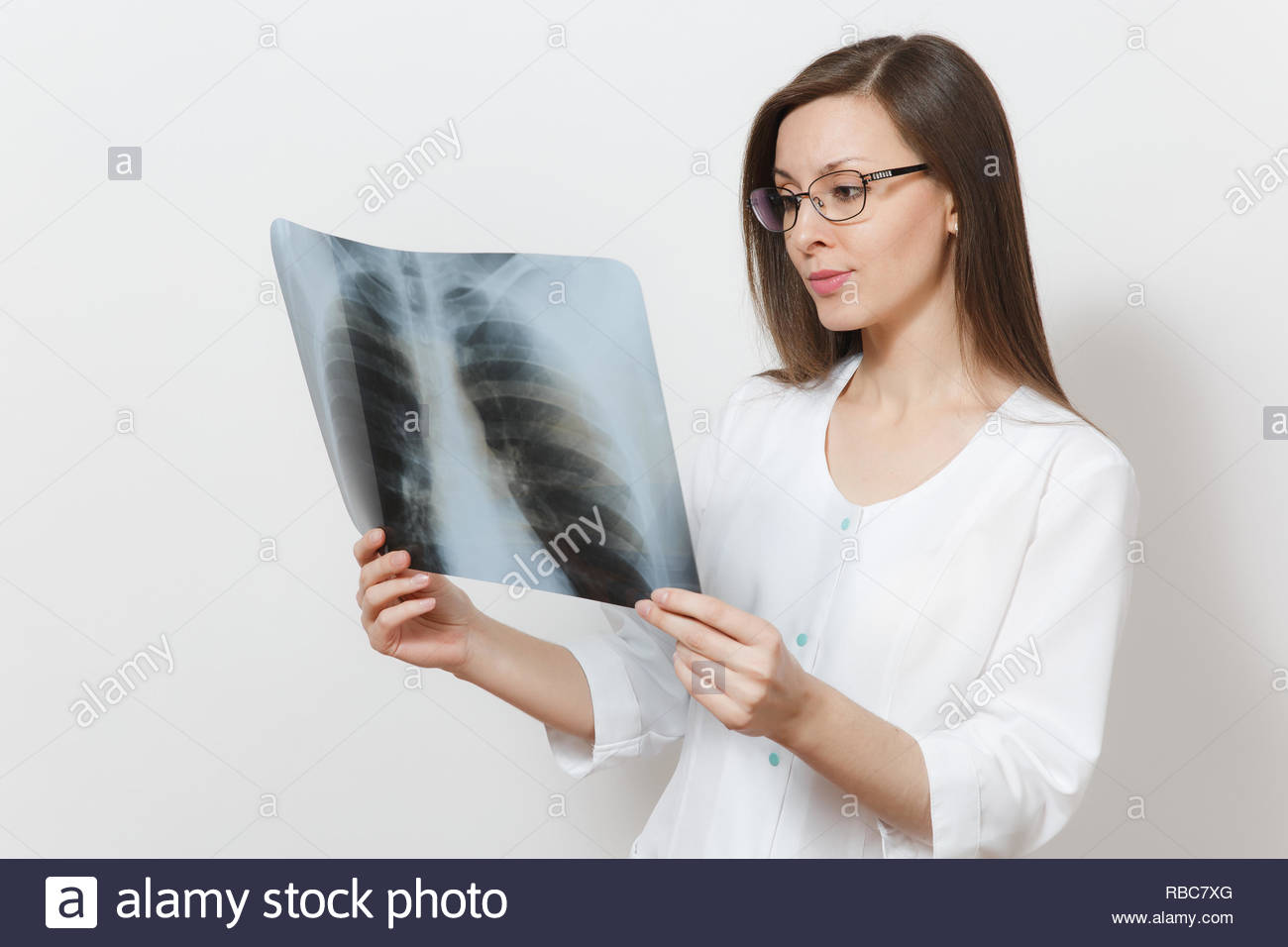 Smiling focused doctor woman with X-ray of lungs, fluorography, roentgen isolated on white background. Female doctor in medical gown stethoscope. Healthcare personnel, medicine concept. Pneumonia. - Stock Image