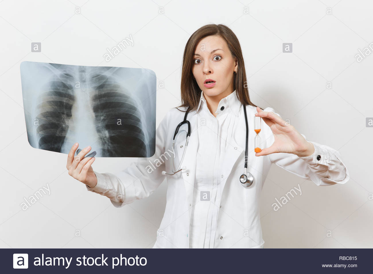 Doctor woman with hourglass, X-ray of lungs fluorography roentgen isolated on white background. Female doctor in medical gown stethoscope. Healthcare personnel time is running out medicine. Pneumonia. - Stock Image