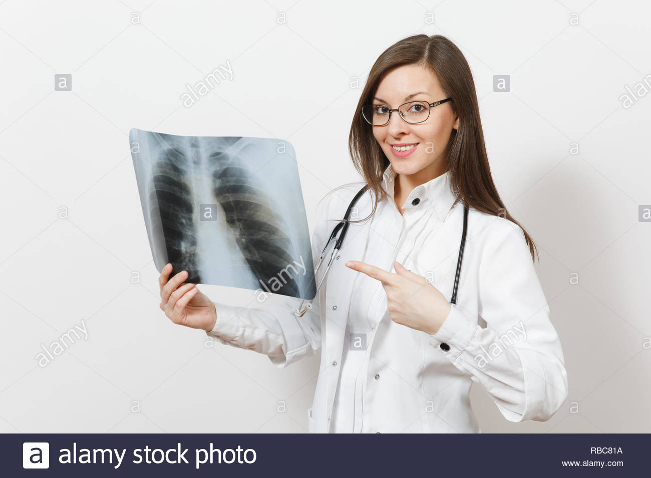 Charming doctor woman pointing index finger on X-ray of lungs, fluorography roentgen isolated on white background. Female doctor in medical gown, stethoscope, glasses. Healthcare personnel. Pneumonia. - Stock Image