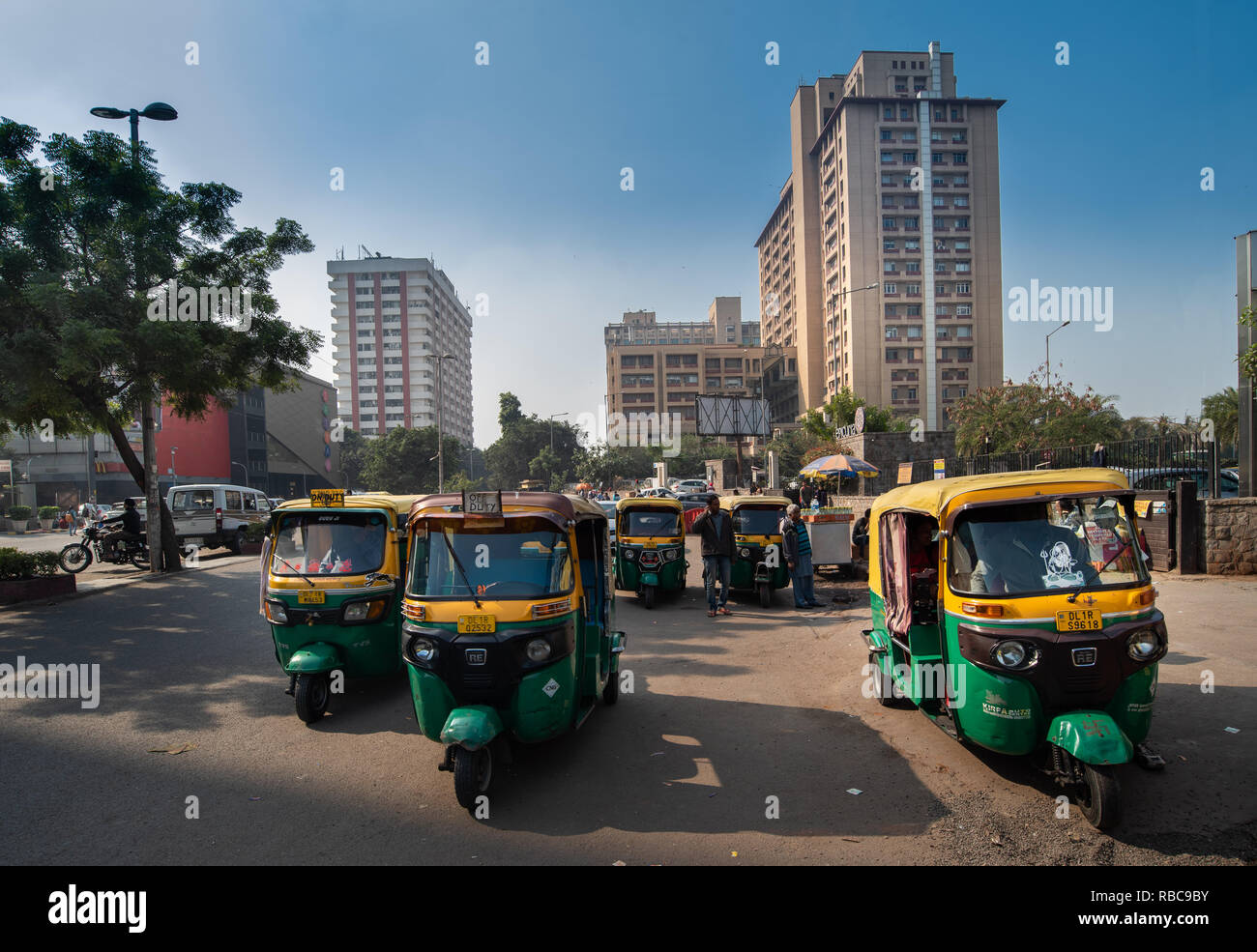 Auto rickshaws waiting for customers near Nehru Place Metro Station with Eros tower in the background, near Satyam Cinema. New Delhi, India Stock Photo