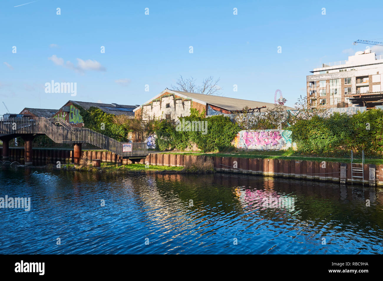 Old warehouses on the River Lea near Bromley-By-Bow, East London UK - Stock Image