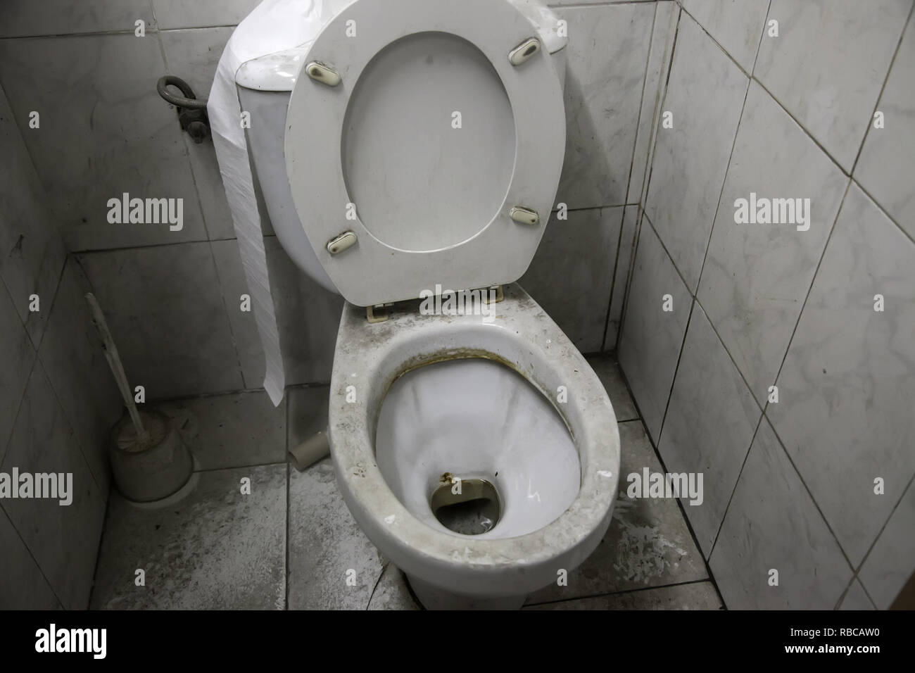 Toilet dirty and full of dust, unhygienic room, abandonment Stock Photo
