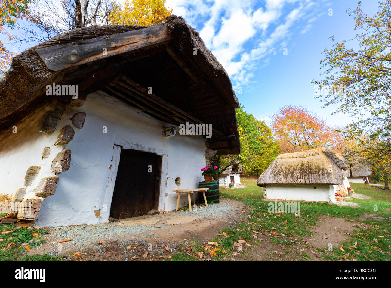 The so called `Row of Wine Cellars` open-air museum in Cak, Hungary. Small houses for pressing grapes and storing fruits, especially sweet chestnut, b - Stock Image