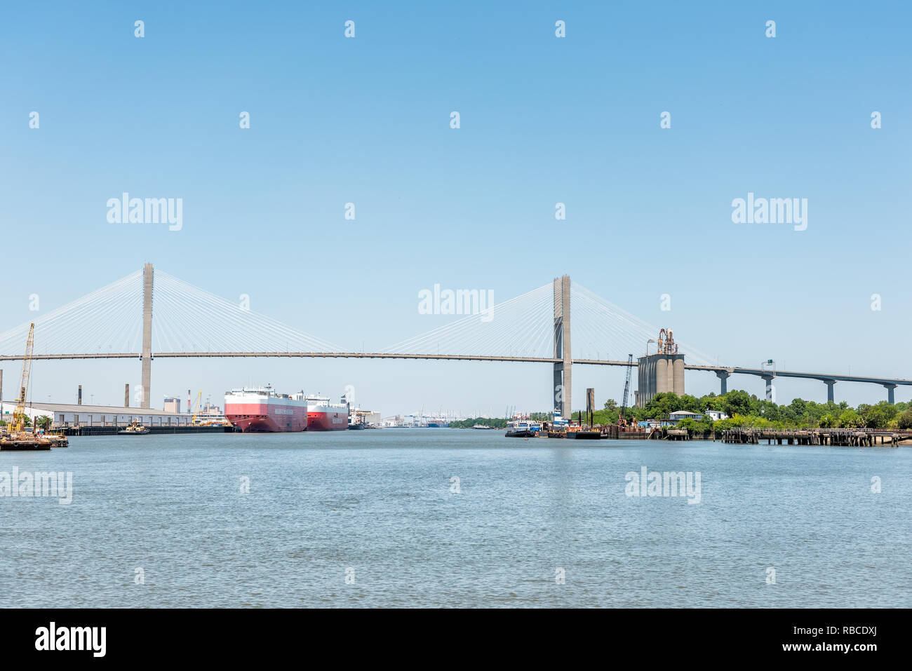 Savannah, USA - May 11, 2018: Old town River in Georgia famous southern town with panoramic view of Talmadge Memorial Bridge during day - Stock Image