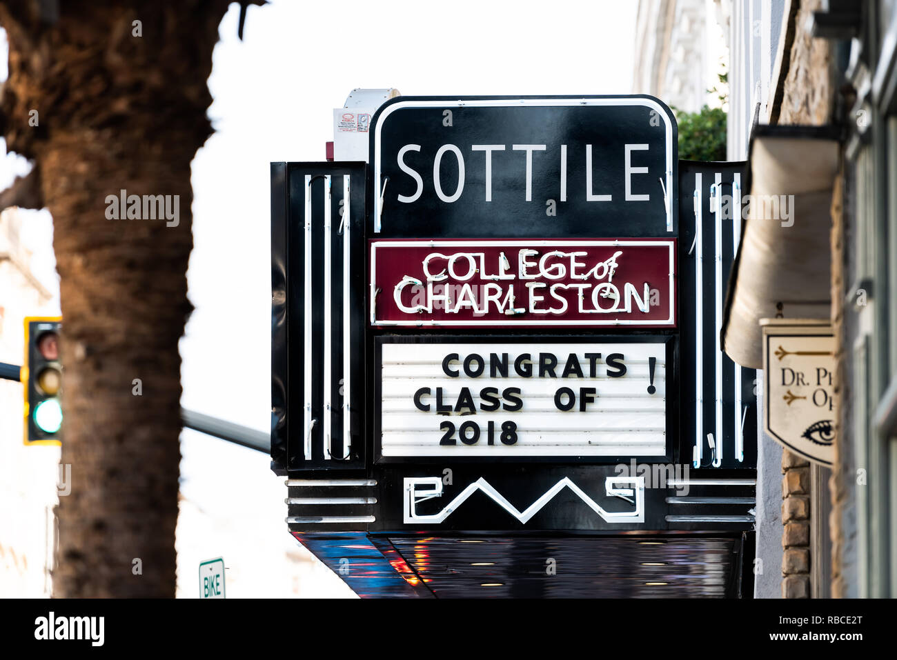 Charleston, USA - May 12, 2018: Downtown city King street in South Carolina with closeup of Sottile theatre and College of Charleston graduation sign - Stock Image