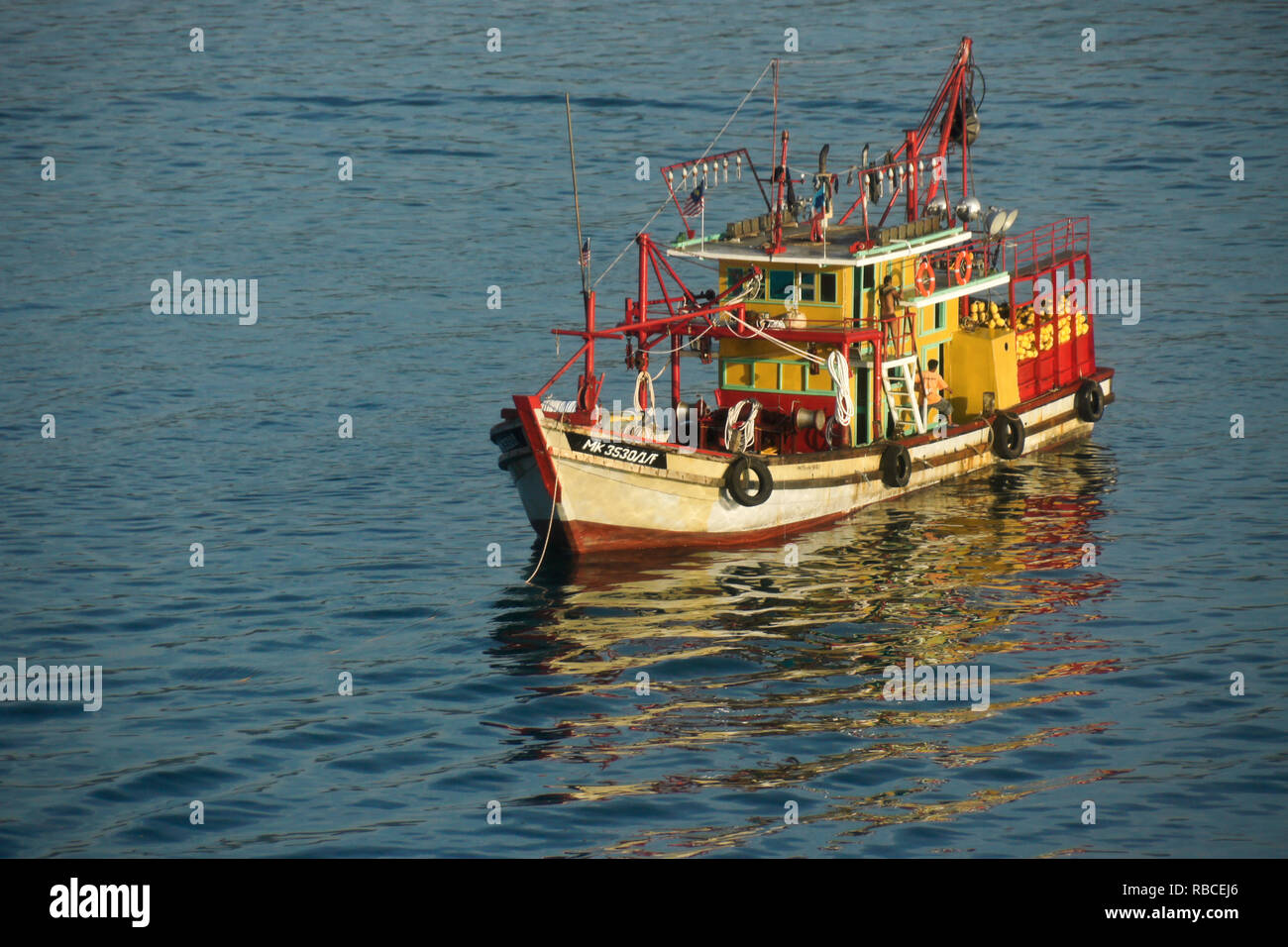 Colorful fishing boat anchored in South China Sea, Kota Kinabalu, Sabah (Borneo), Malaysia - Stock Image