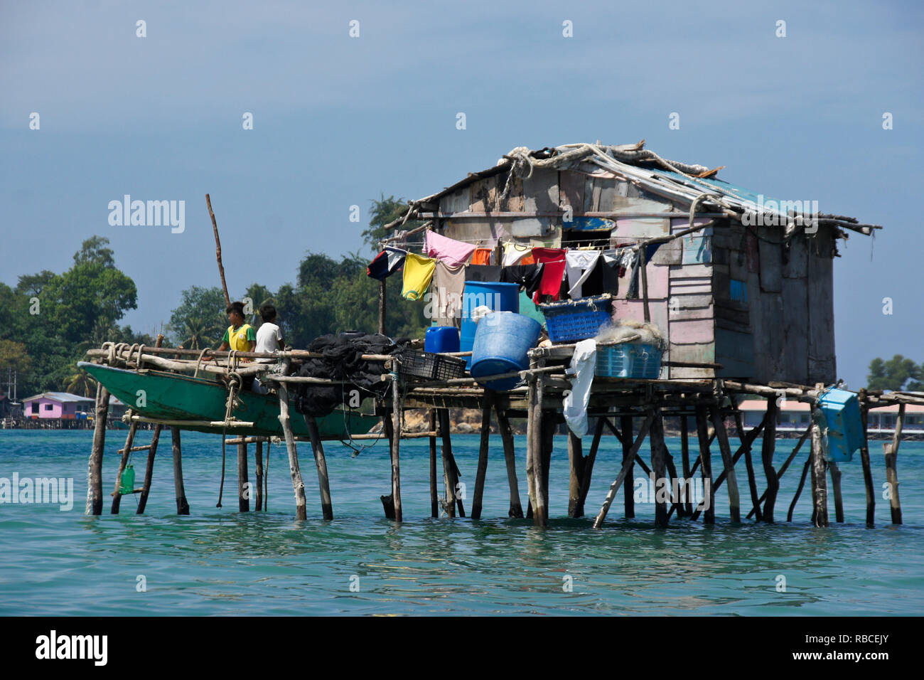 Dwelling built on stilts in South China Sea near Kota Kinabalu, Sabah (Borneo), Malaysia - Stock Image