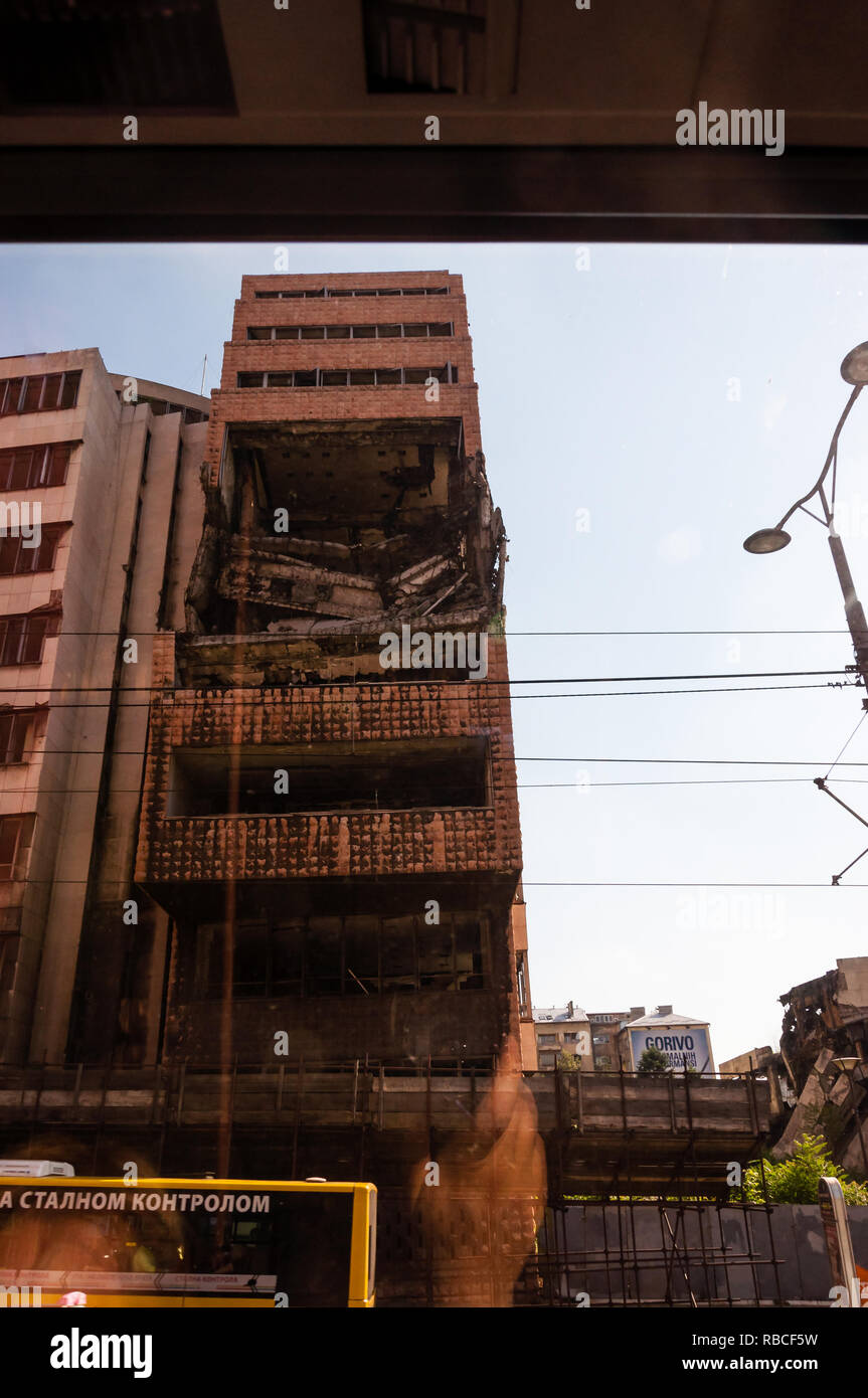 Belgrade, Serbia - June 09, 2013: View from autobus window on destroyed part of downtown building in Belgrade after airstrikes in civil war Stock Photo