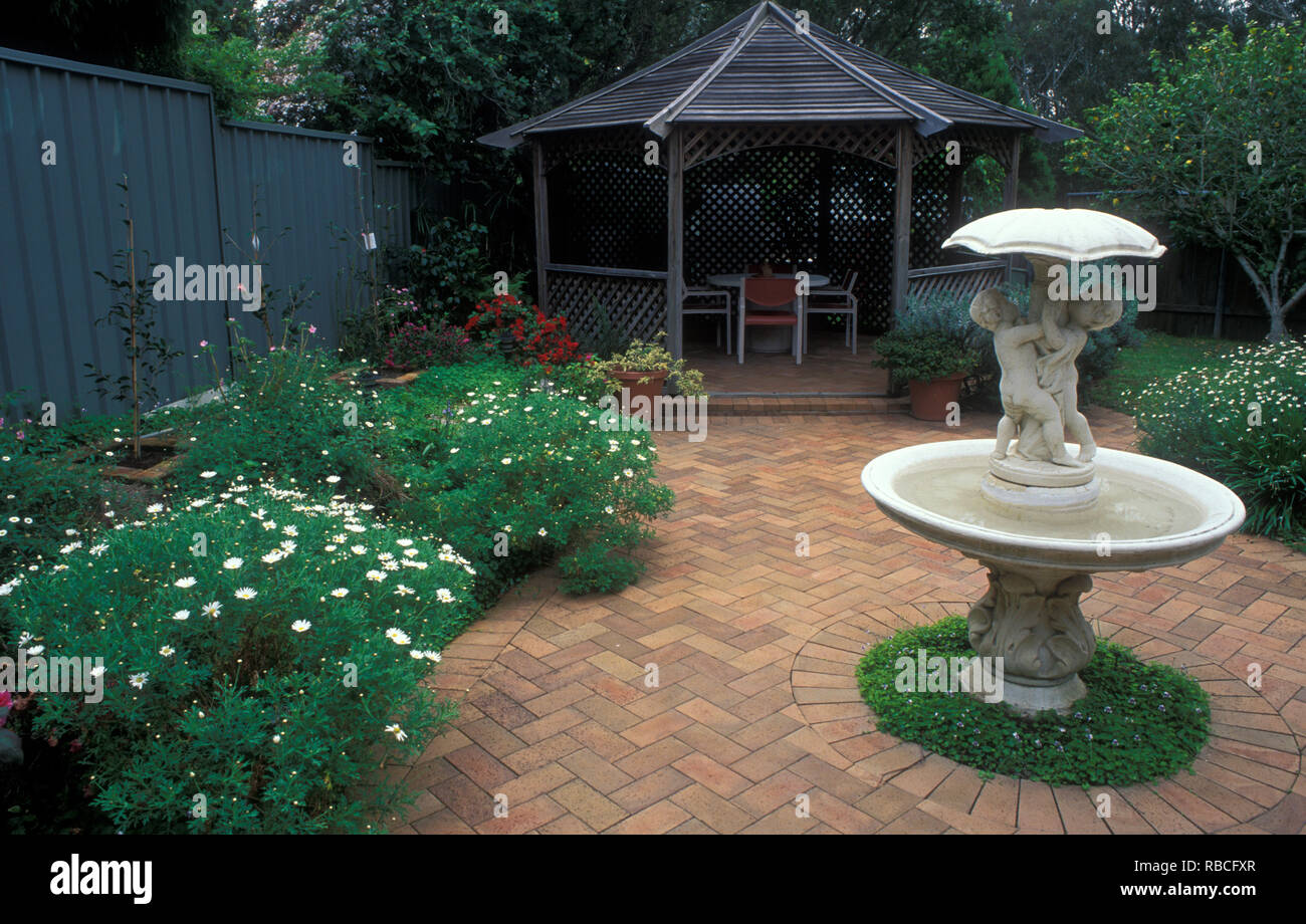 Courtyard Style Garden Featuring Paving Fountain Gazebo With