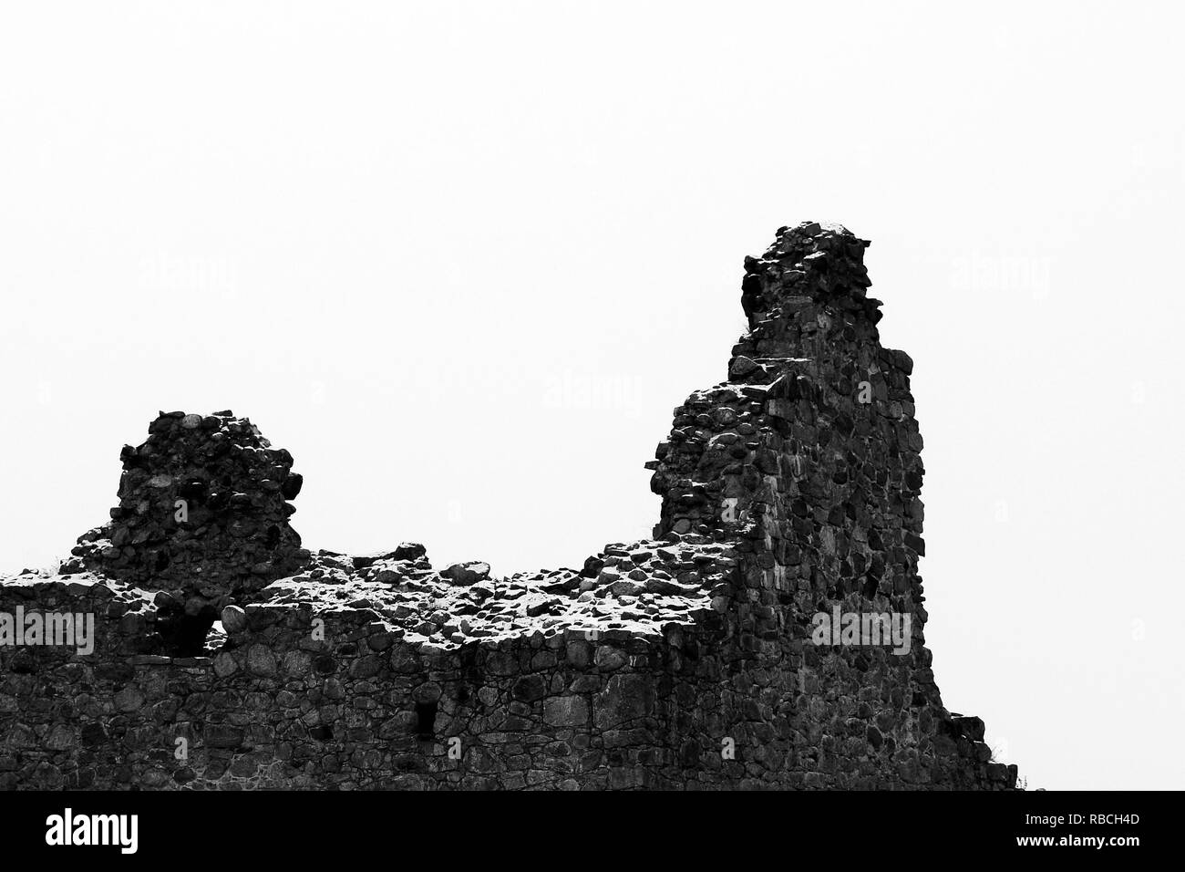 Collapsed ruins of old castle. Dramatic black and white image with copy space. - Stock Image