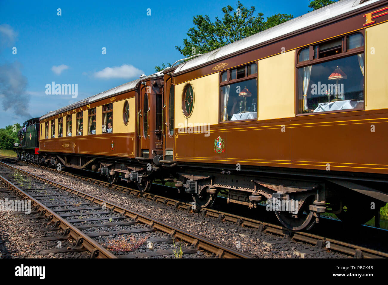 British Railways 30541 hauling Pullman coaches out of Sheffield Park station - Stock Image