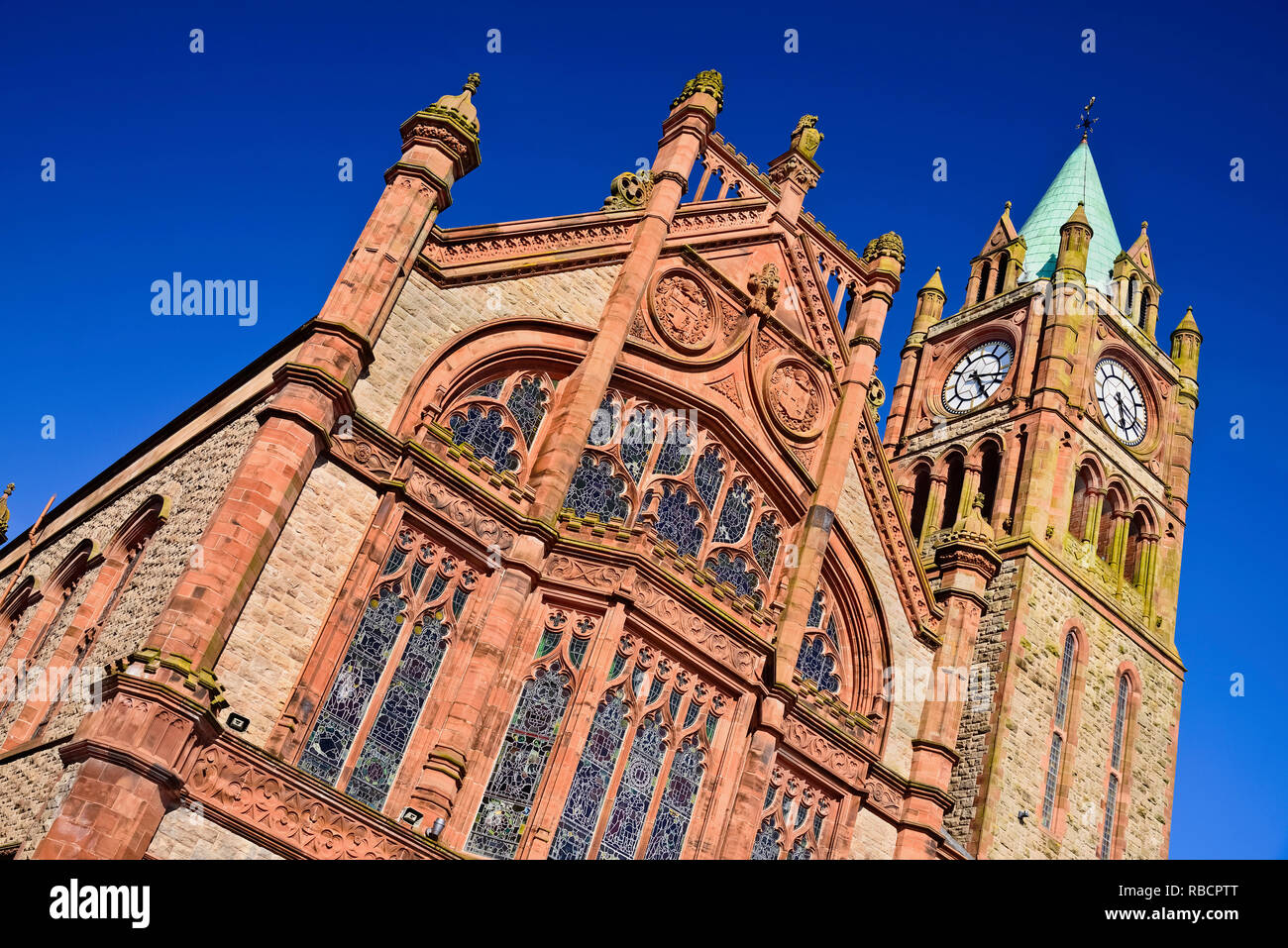 Northern Ireland, County Derry, The Guild Hall, a section of its Neo Gothic facade and the clock Tower. - Stock Image