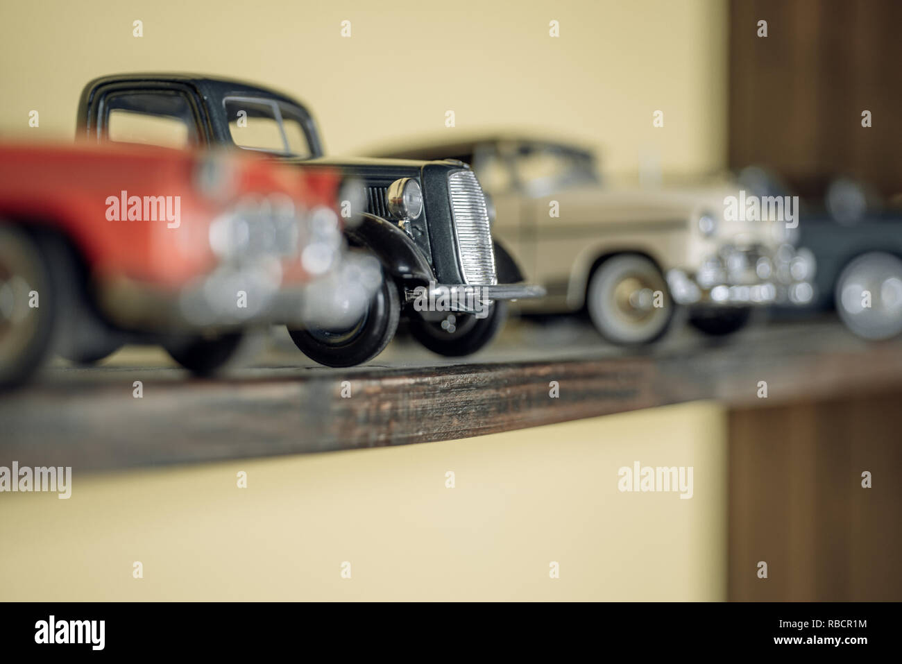 Vintage inspired. Retro car models on shelf. Retro styled cars. Toy cars with retro design. Classic model vehicles or toy vehicles. Miniature collection of automobiles - Stock Image