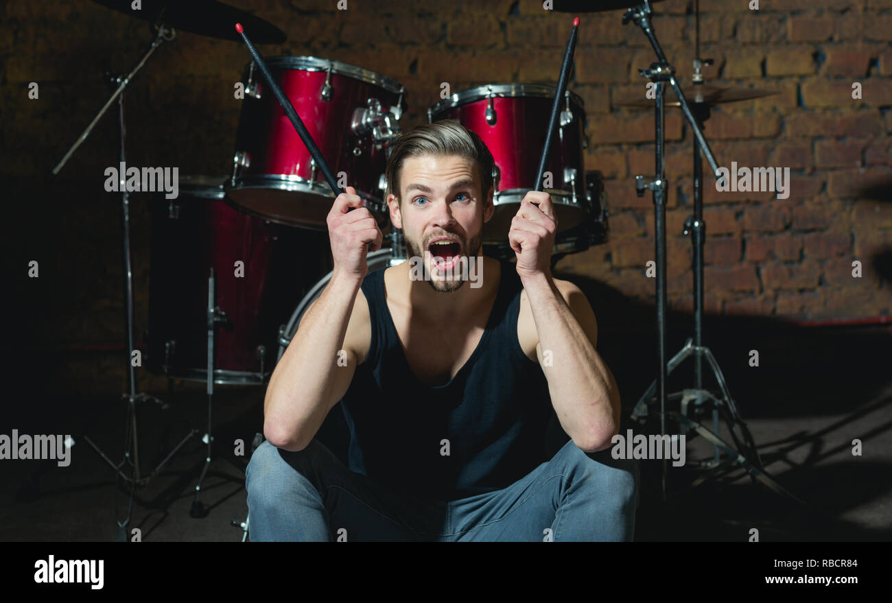 I got the beat. Rock star or rocker. Excited man sit on stage at percussion instrument. Man drummer with musical instrument. Rock concert or rehearsal in music club. Enjoying instrumental music - Stock Image