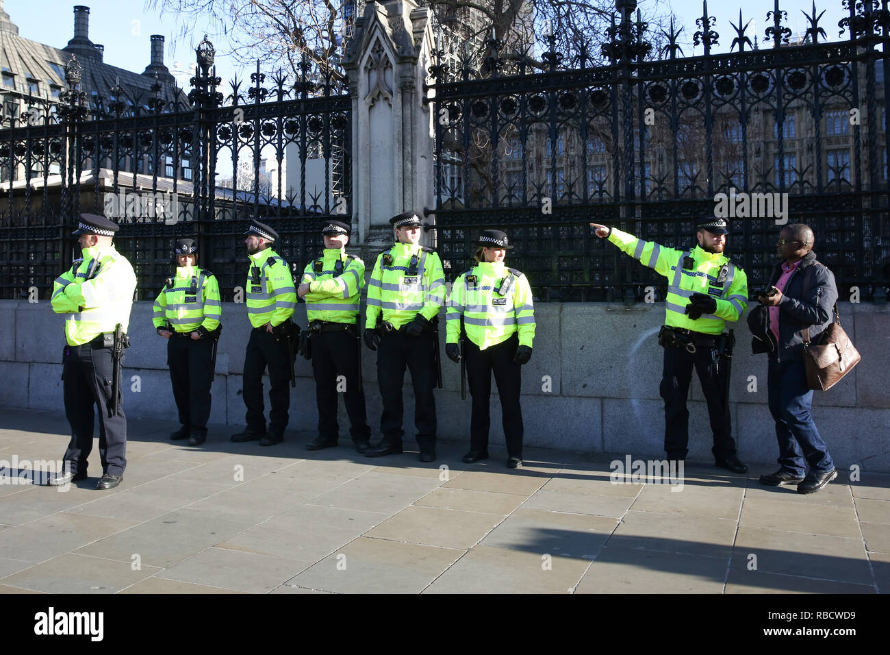 Extras police officers seen outside the House of Parliament in Westminster. Anti-Brexit demonstrators gather outside the British Parliament a week before the MPs to vote on the finalized Brexit deal, MPs will vote on Theresa May's Brexit deal on 15 January. - Stock Image