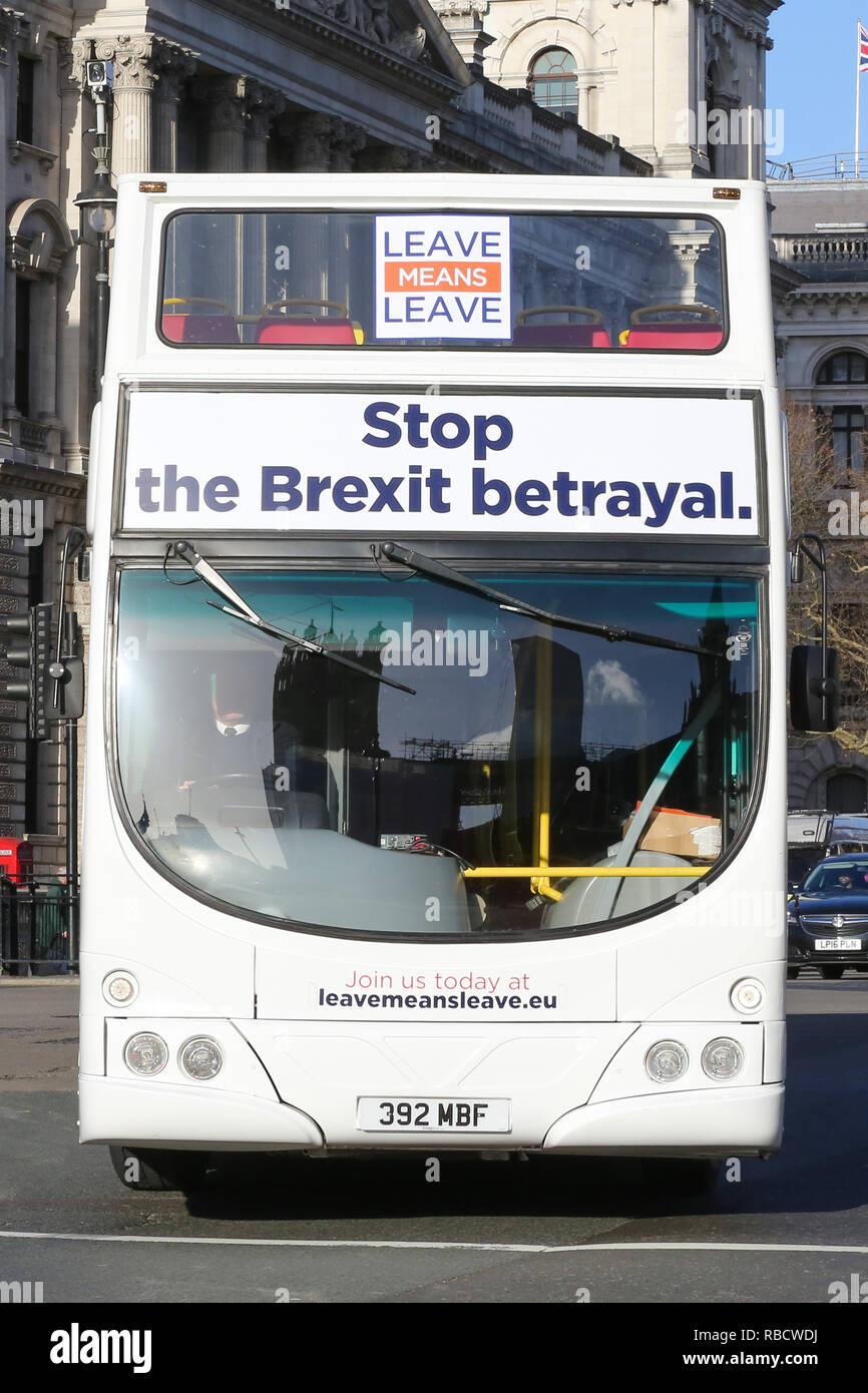 "A pro brexit double decker bus seen running on the street of London during the protest. Anti Brexit demonstrators gather outside the British Parliament a week before the MPs to vote on the finalized Brexit deal, MPs will vote on Theresa May's Brexit deal on Tuesday, 15 January."" Stock Photo"