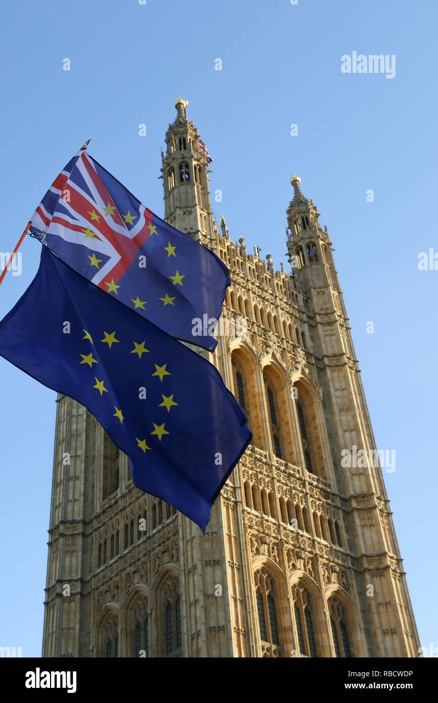 The European Union flag and the union jack flag are seen hanging together during the protest. Anti Brexit demonstrators gather outside the British Parliament a week before the MPs to vote on the finalized Brexit deal, MPs will vote on Theresa May's Brexit deal on Tuesday, 15 January.' - Stock Image
