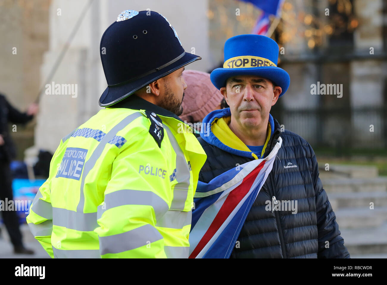 A pro-Brexit demonstrator seen wearing a blue hat saying stop Brexit during the protest. Anti Brexit demonstrators gather outside the British Parliament a week before the MPs to vote on the finalized Brexit deal, MPs will vote on Theresa May's Brexit deal on Tuesday, 15 January.' - Stock Image
