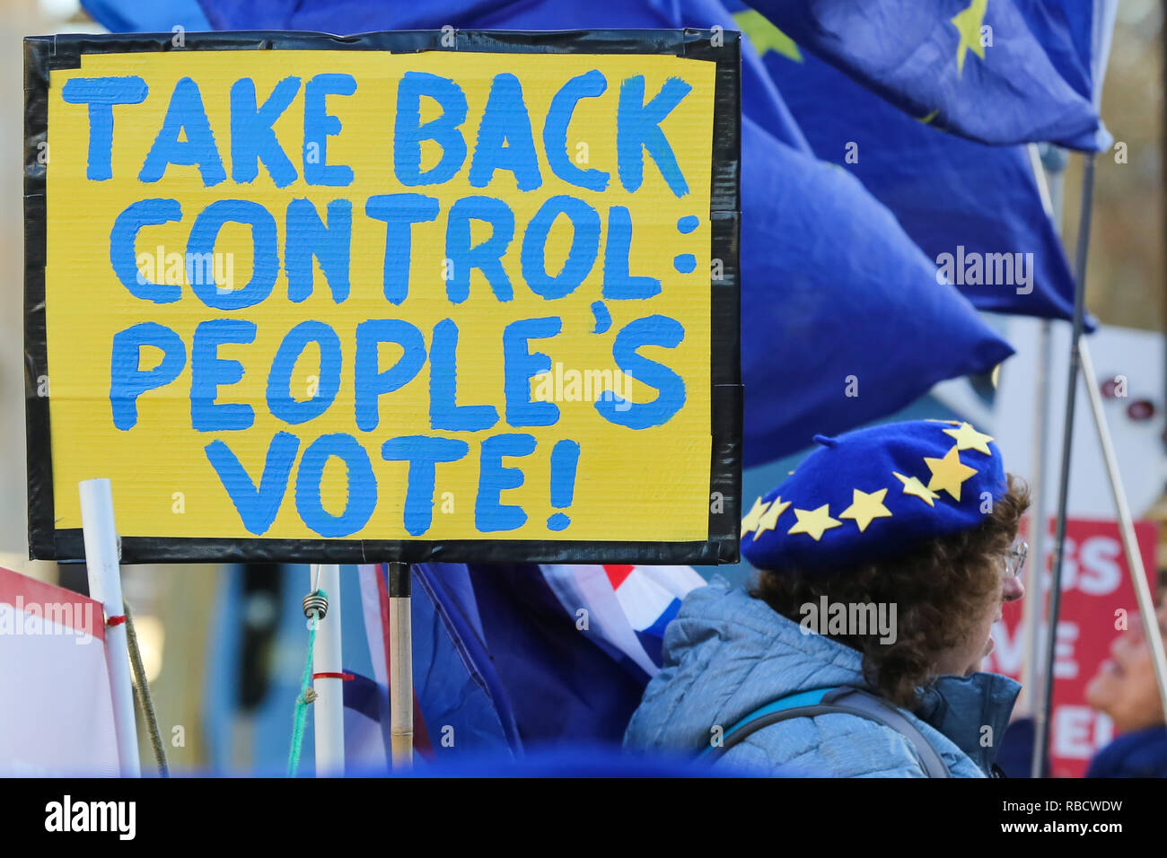 A placard saying take back control peoples vote seen during the protest. Anti Brexit demonstrators gather outside the British Parliament a week before the MPs to vote on the finalized Brexit deal, MPs will vote on Theresa May's Brexit deal on Tuesday, 15 January.' - Stock Image
