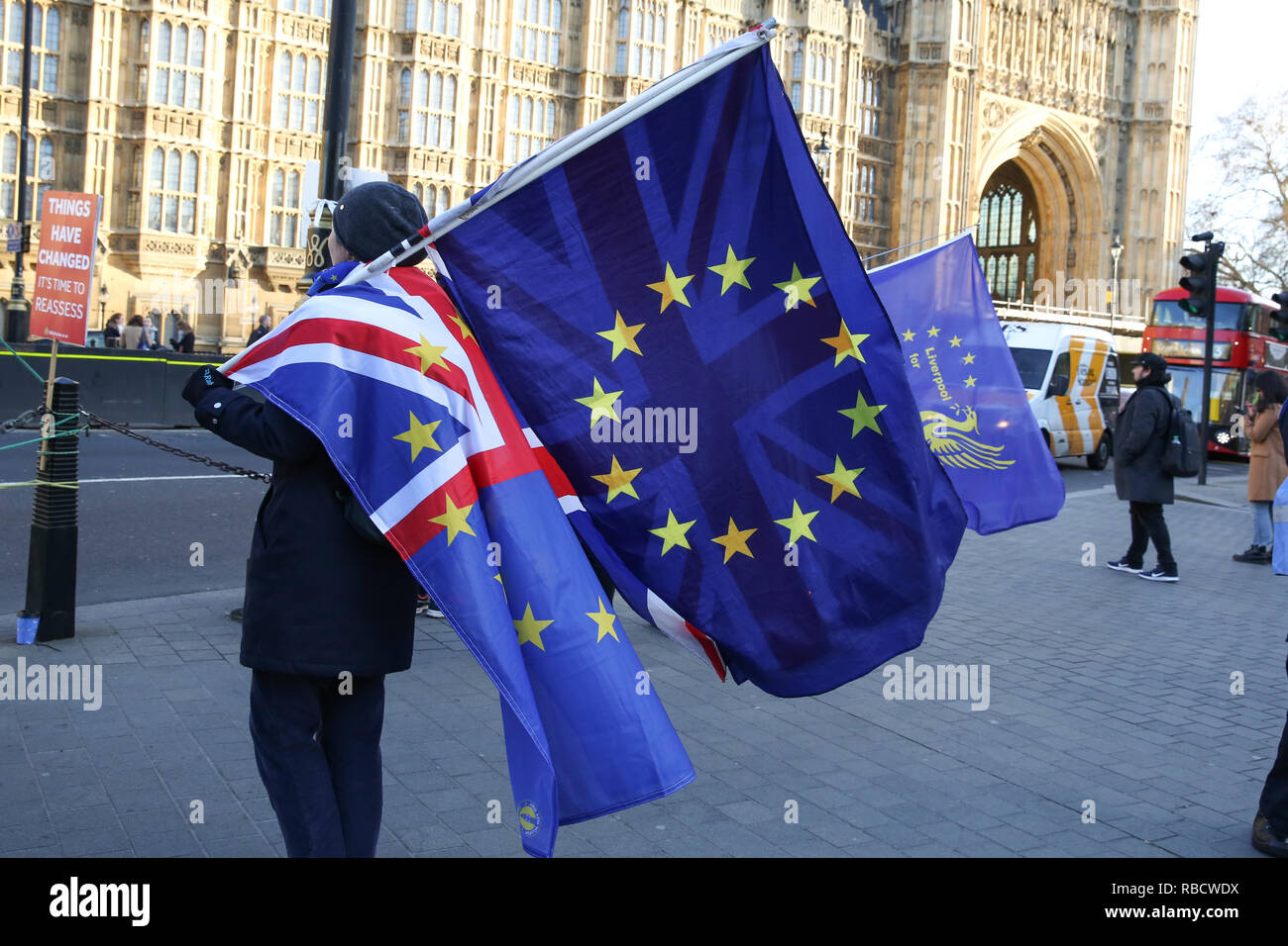 Anti-Brexit demonstrators seen holding the European Union flag and the union jack flag during the protest. Anti Brexit demonstrators gather outside the British Parliament a week before the MPs to vote on the finalized Brexit deal, MPs will vote on Theresa May's Brexit deal on Tuesday, 15 January.' - Stock Image