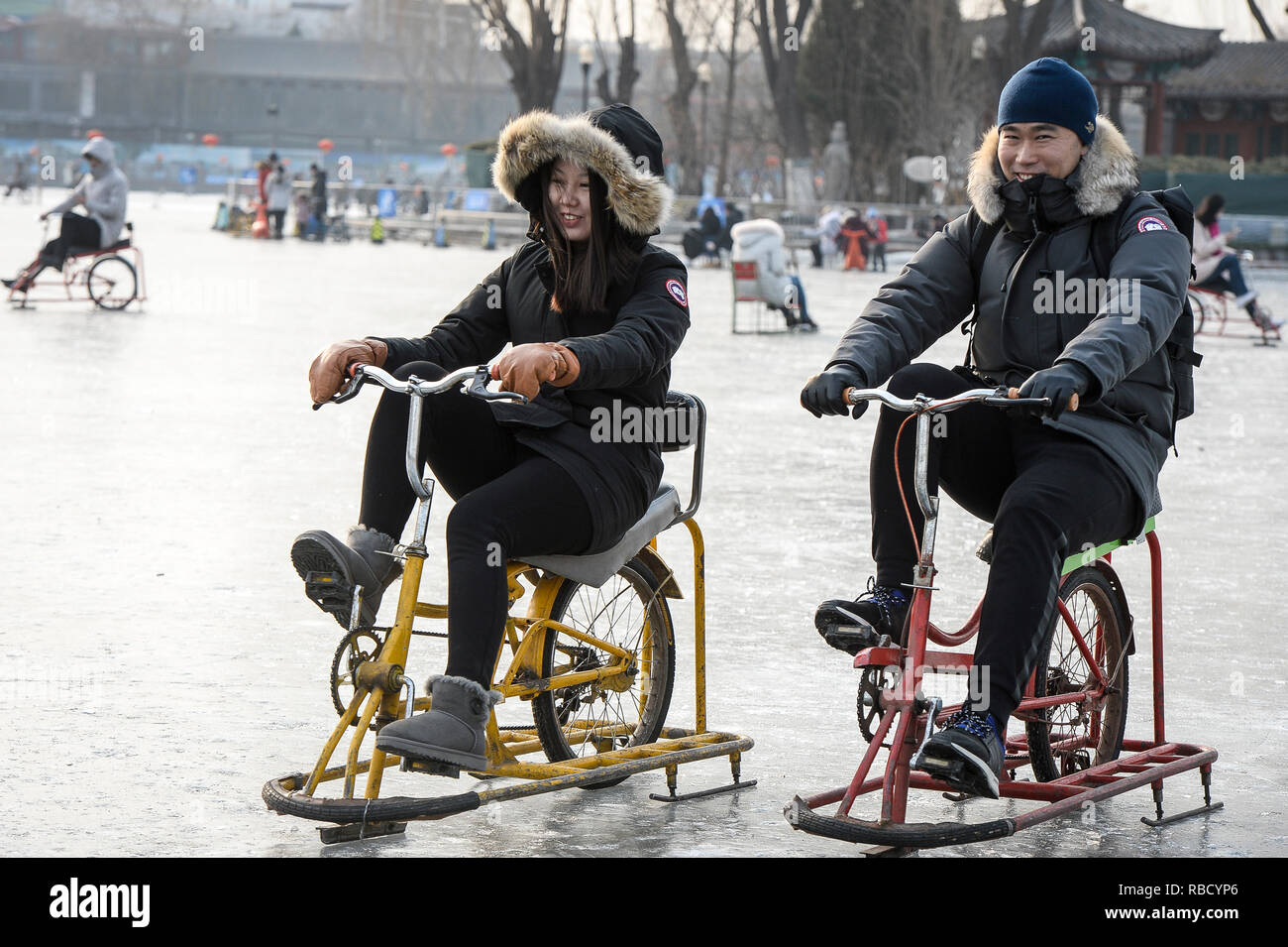 Beijing, China. 09th Jan, 2019. People ride ice bikes and skating on a frozen Qianhai lake in the center of Beijing, China on 09/01/2019 by Wiktor Dabkowski | usage worldwide Credit: dpa/Alamy Live News - Stock Image