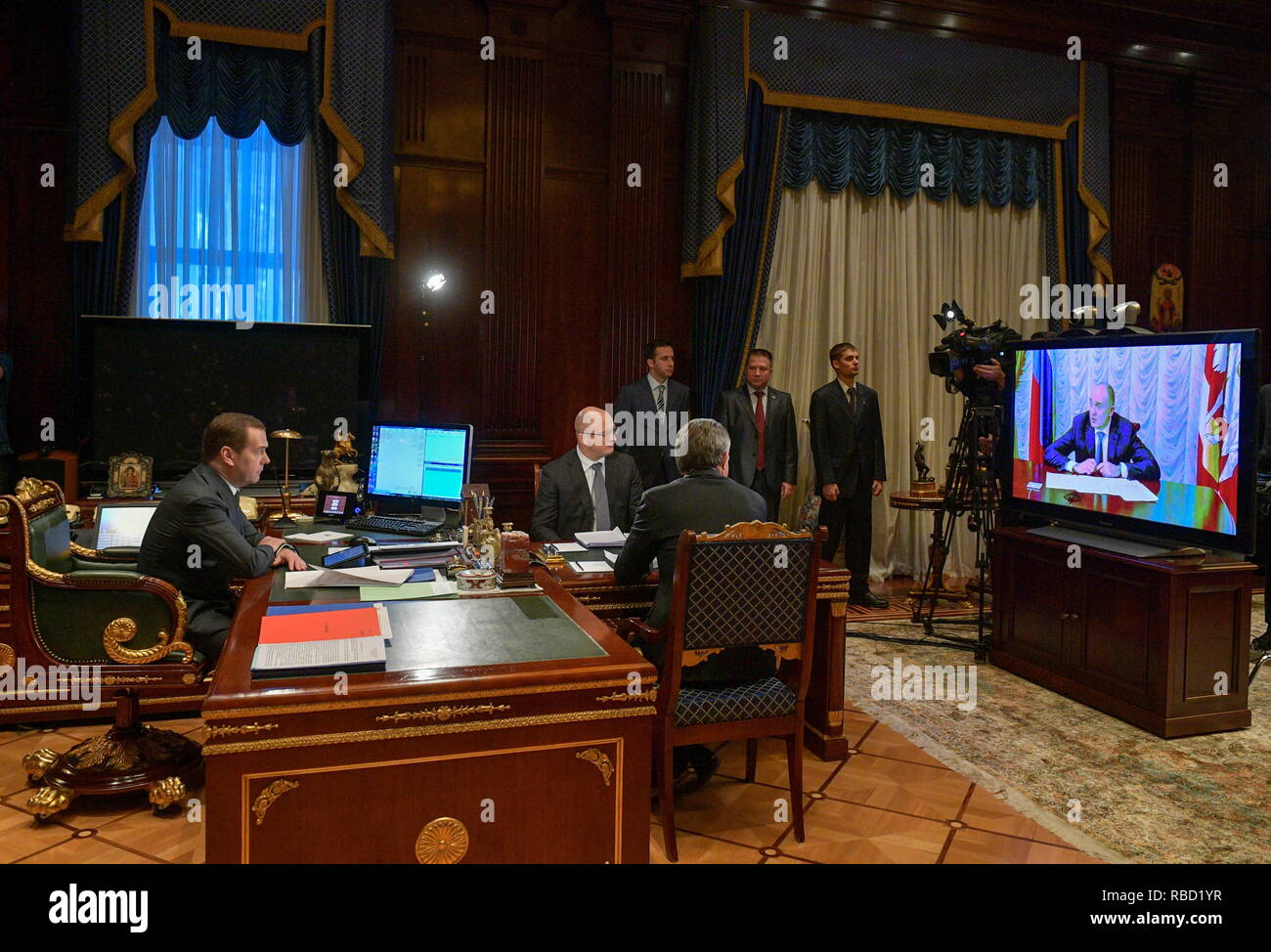 Russia. 09th Jan, 2019. MOSCOW REGION, RUSSIA - JANUARY 9, 2019: Russia's Prime Minister Dmitry Medvedev (L) during a video conference meeting on the recovery operation after the Magnitogorsk domestic gas explosion at Gorki residence. Chelyabinsk Region Governor Boris Dubrovsky takes part in the meeting via a video link. Alexander Astafyev/Russian Government Press Office/TASS Credit: ITAR-TASS News Agency/Alamy Live News - Stock Image