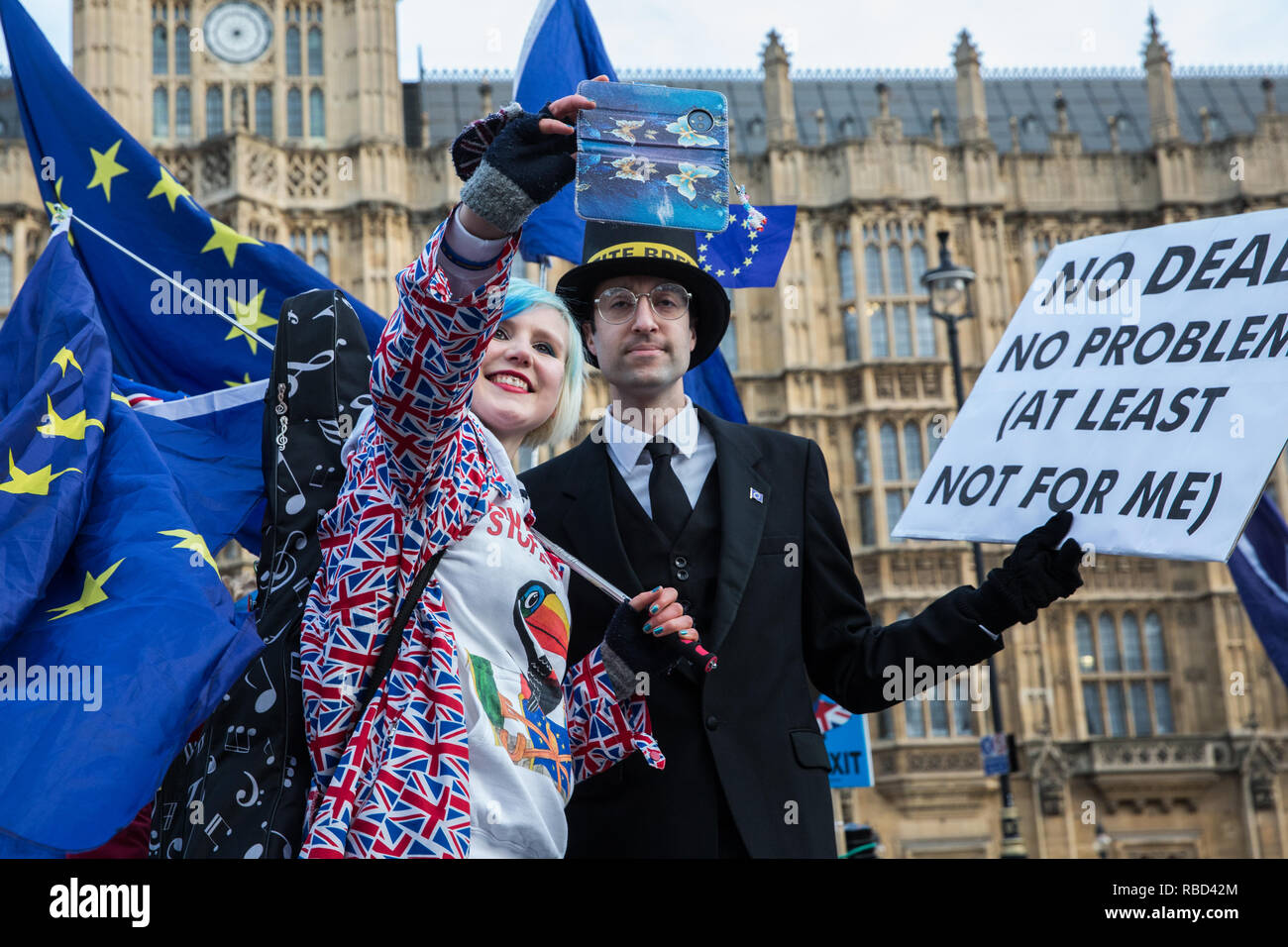 London, UK. 9th Jan, 2019. EU Supergirl Madeleina Kay stands with a fellow anti-Brexit activist disguised as Jacob Rees-Mogg and carrying a sign reading 'My Money's on Brexit My Money's in Ireland' during a protest by pro-EU group SODEM (Stand of Defiance European Movement) outside Parliament on the first day of the debate in the House of Commons on Prime Minister Theresa May's proposed Brexit withdrawal agreement. Credit: Mark Kerrison/Alamy Live News - Stock Image