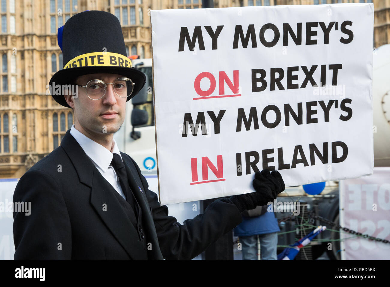 London, UK. 9th Jan, 2019. An anti-Brexit activist disguised as Jacob Rees-Mogg and carrying a sign reading 'My Money's on Brexit My Money's in Ireland' protests with pro-EU group SODEM (Stand of Defiance European Movement) outside Parliament on the first day of the debate in the House of Commons on Prime Minister Theresa May's proposed Brexit withdrawal agreement. Credit: Mark Kerrison/Alamy Live News - Stock Image