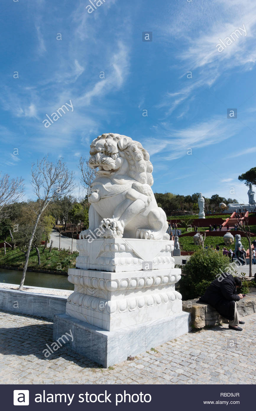 a marble sculpture of a chinese foo dog, at Quinta dos Loridos Bombarrel Portugal - Stock Image